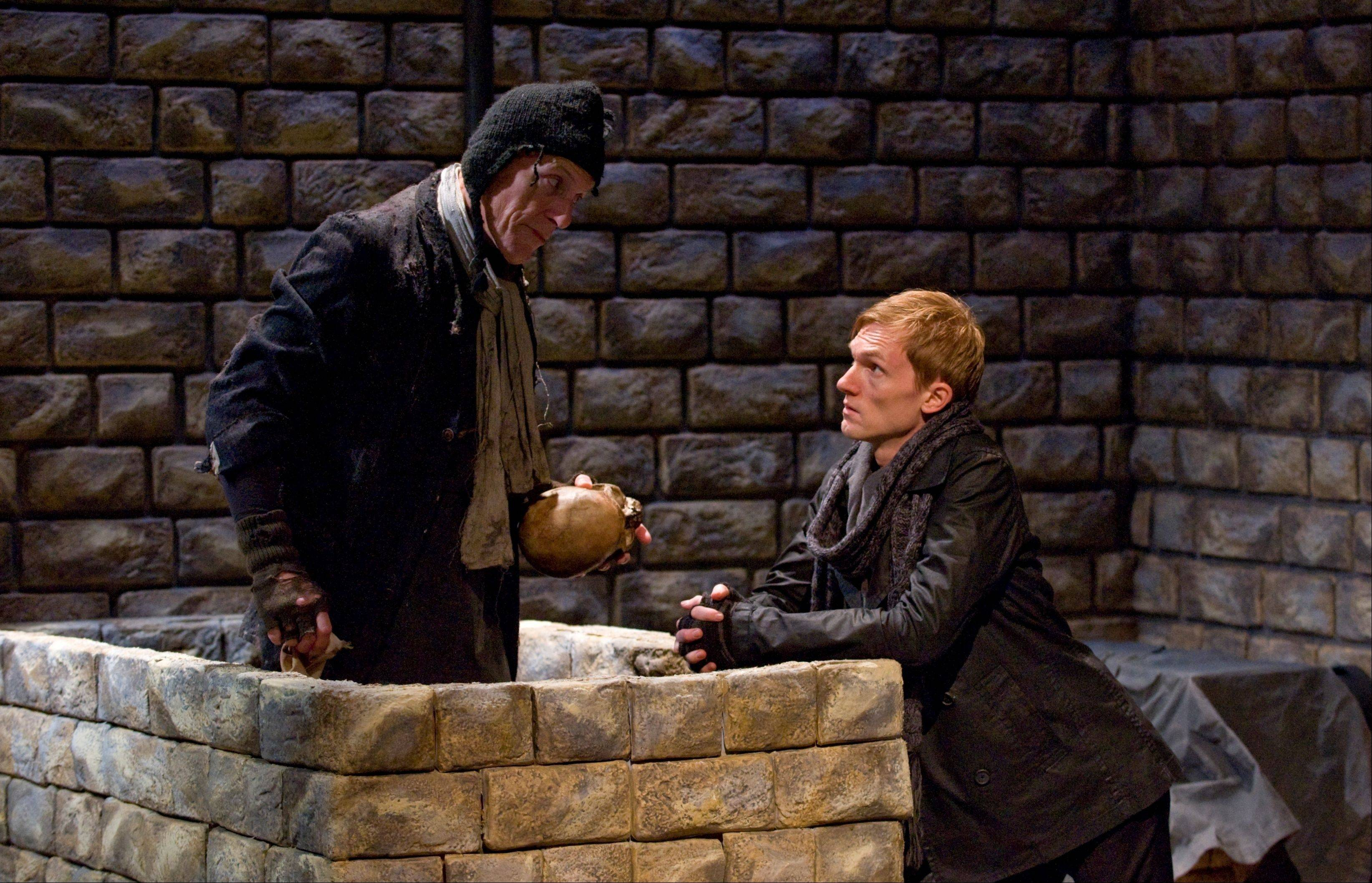 "Hamlet (Scott Parkinson), right, converses with a gravedigger (Larry Yando) in director Michael Halberstam's intelligent production of Shakespeare's ""Hamlet"" for Writers' Theatre."