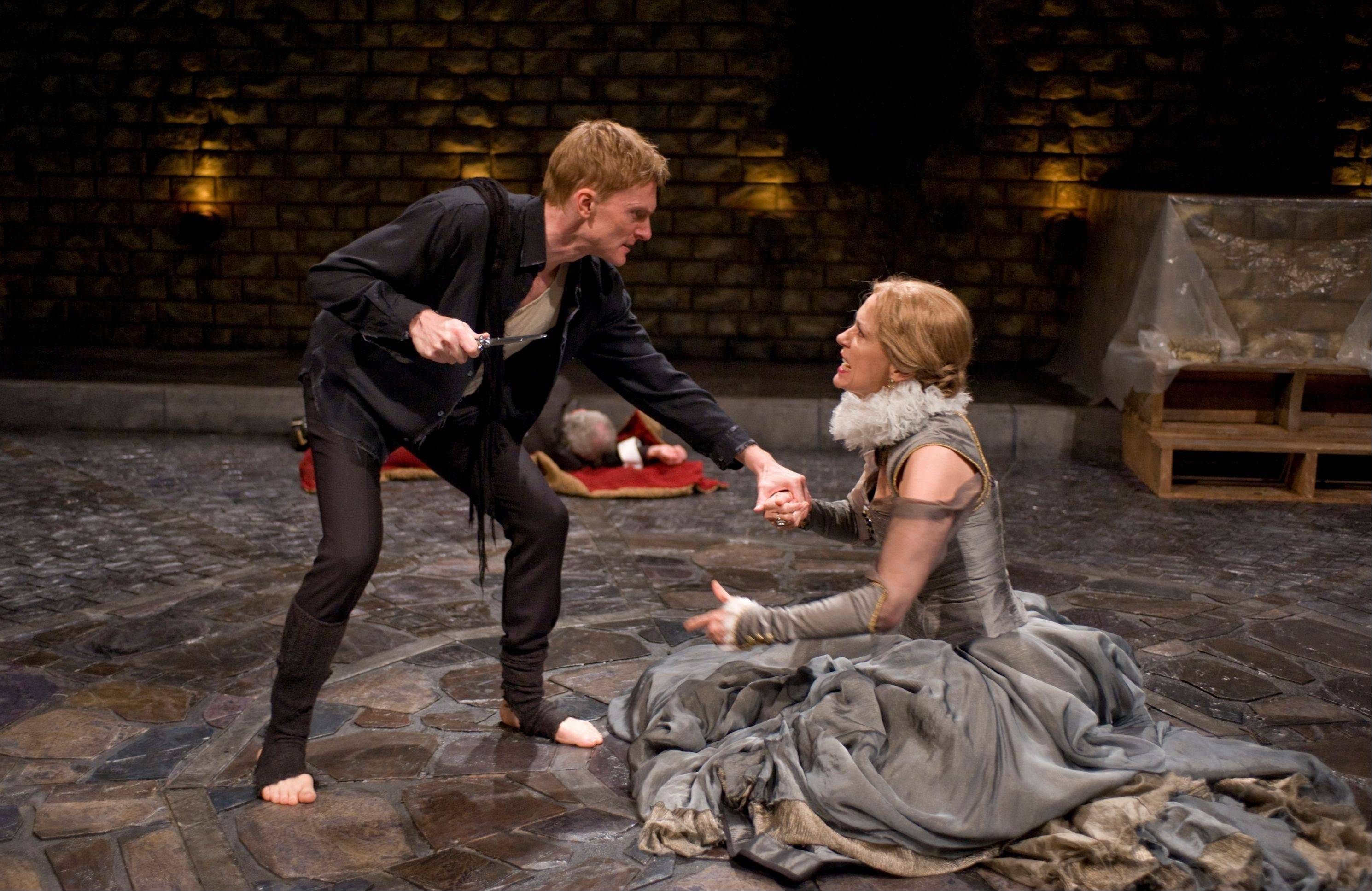 "Queen Gertrude (Shannon Cochran) realizes how profoundly her husband's death and her hasty remarriage has affected her distraught son (Scott Parkinson) in Writers' Theatre's exceptional production of ""Hamlet."""