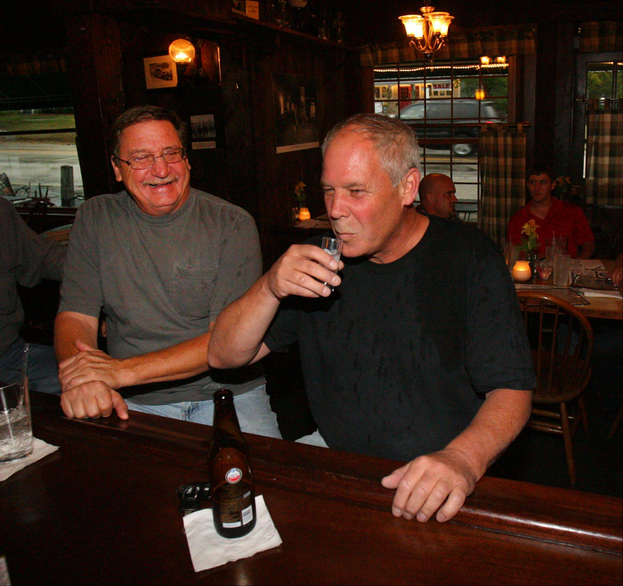 Bob Rosencrans of Buffalo Grove, left, and Tim Breen of Long Grove enjoy drinks at The Village Tavern.