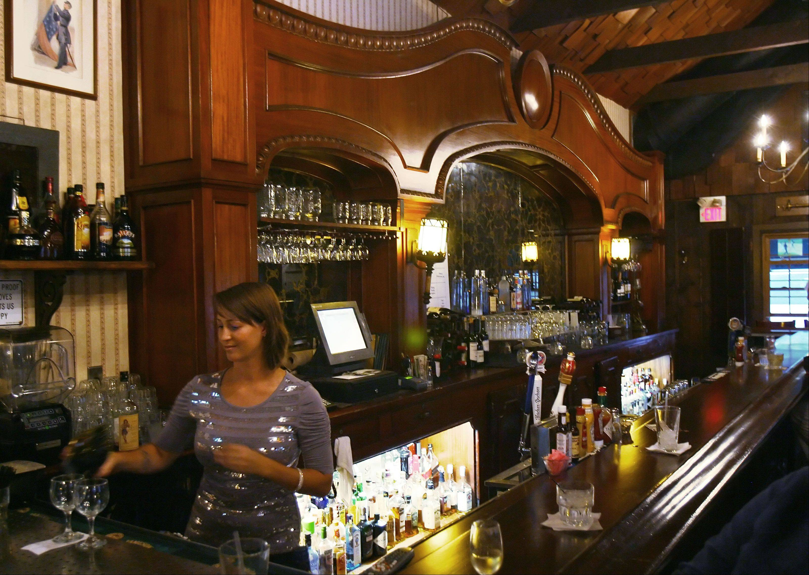 "The 35-foot mahogany bar, which survived Chicago's ""Great McCormick Place Fire"" in the 1960s, is the centerpiece of The Village Tavern in Long Grove."