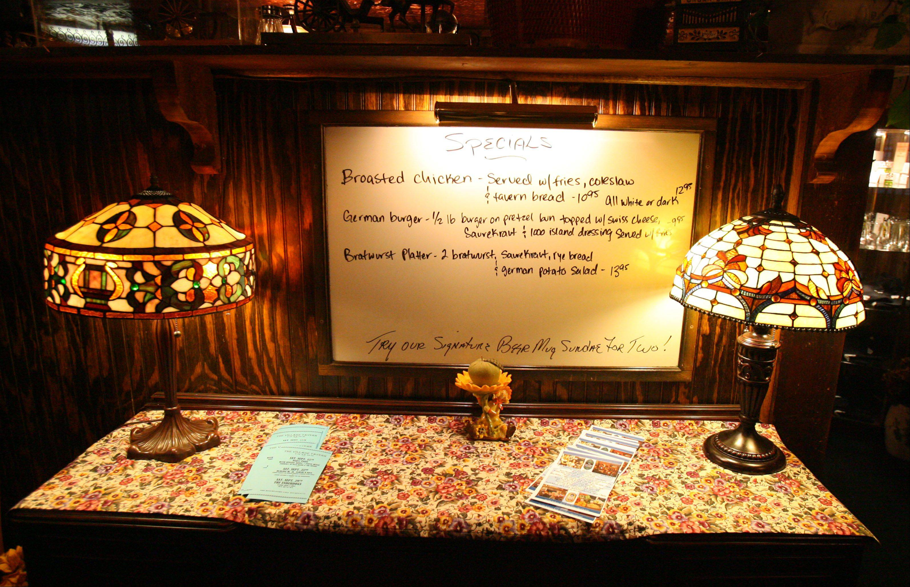 A board lists the specials as you enter The Village Tavern.