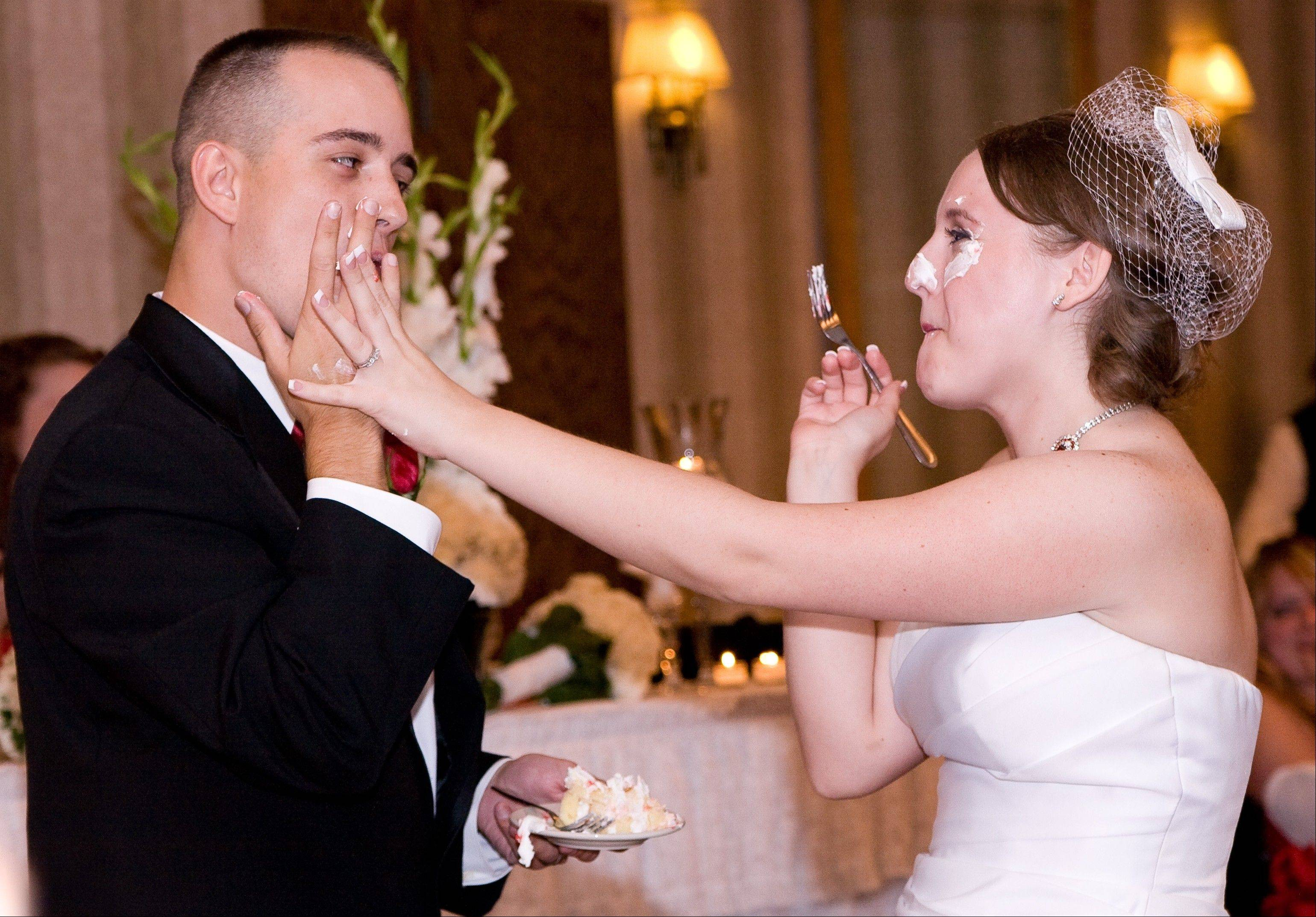 Tyson and Sarah Jones of Portsmouth, Va., shove cake into each other's faces at their wedding in June 2010. I was able to capture a fun moment between this couple, because they forgot for a brief moment that they were being photographed.