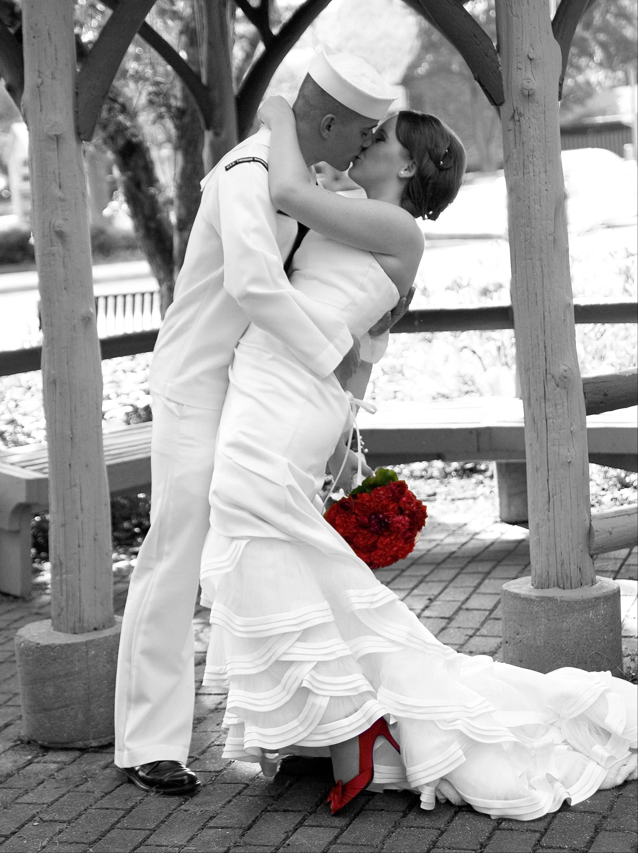 Sarah and Tyson Jones of Portsmouth, Va., pose for a photo on their wedding day in June 2010. The couple requested that I mimic the photo of a sailor kissing a nurse that was taken during the celebration of the end of World War II in Times Square.