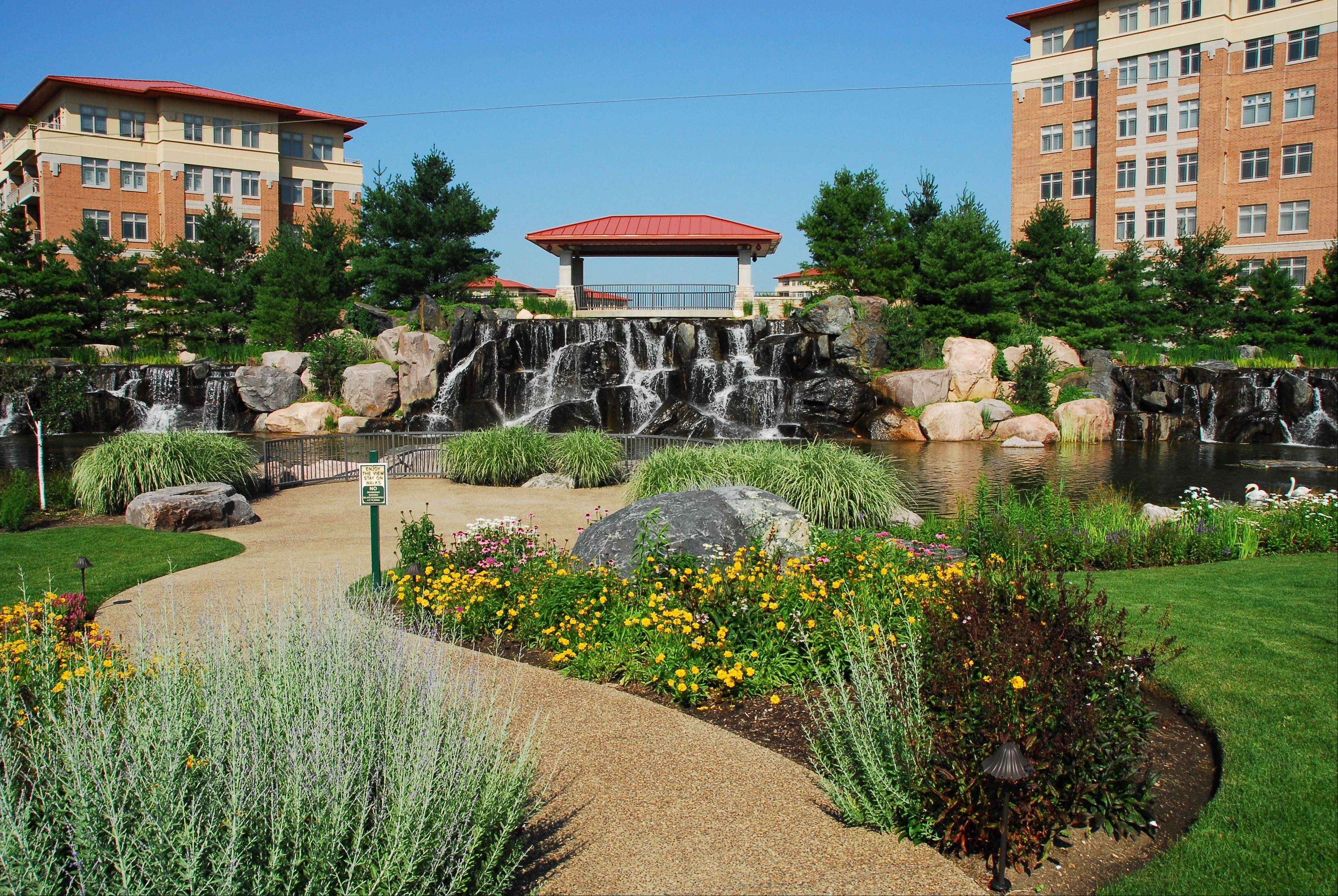 Prairie landscaping and a waterfall attract buyers and guests to the Prairie Park condominiums in Wheeling.