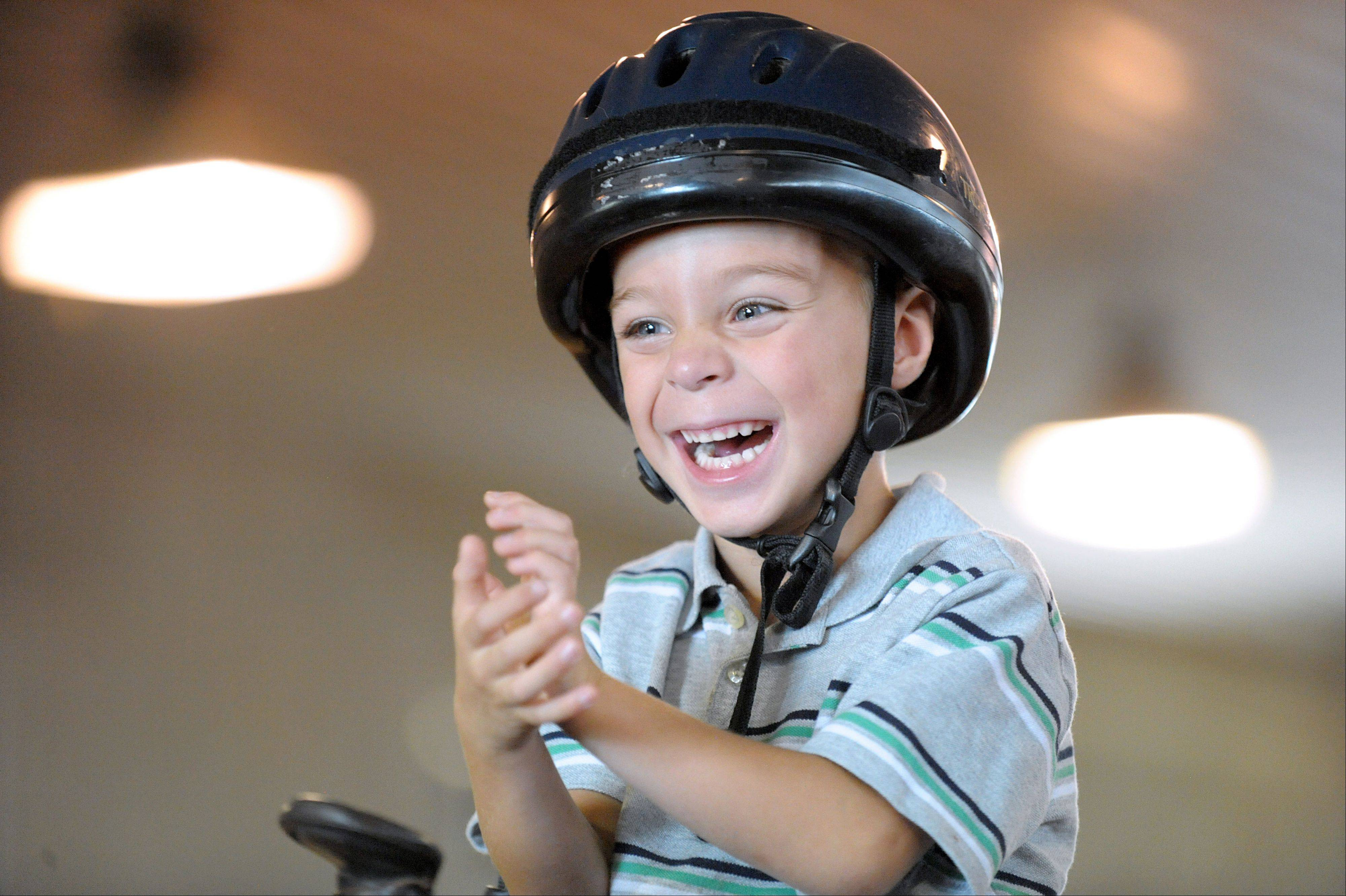 Trevin Kuhl, 4, of Sycamore, couldn't be happier during a game atop his therapy horse, Ronan, at HorsePower Therapeutic Riding in Maple Park.
