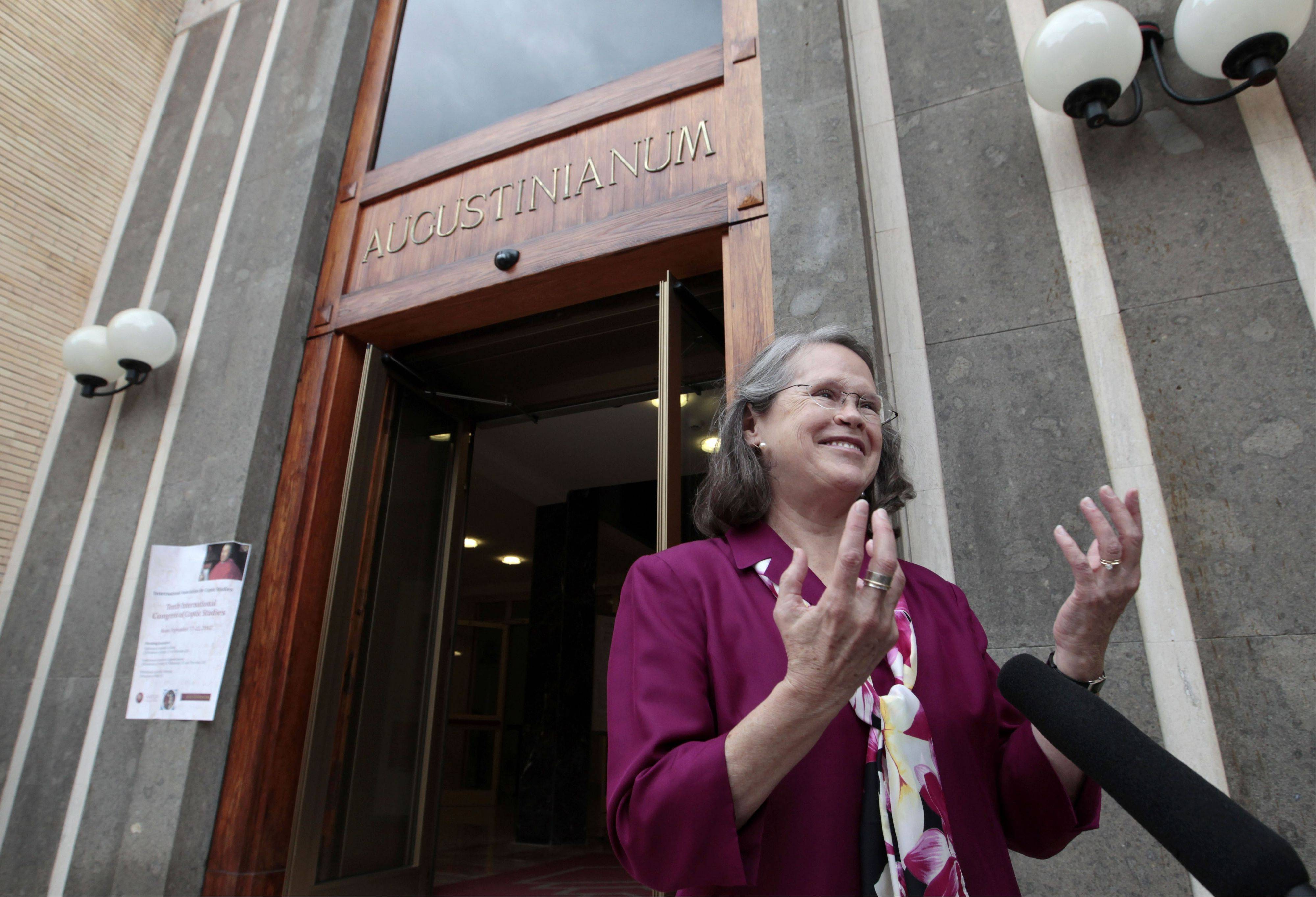 Karen L. King, a professor at Harvard Divinity School, speaks to the media Wednesday outside the Augustinianum institute, where an international congress on Coptic studies was being held in Rome.