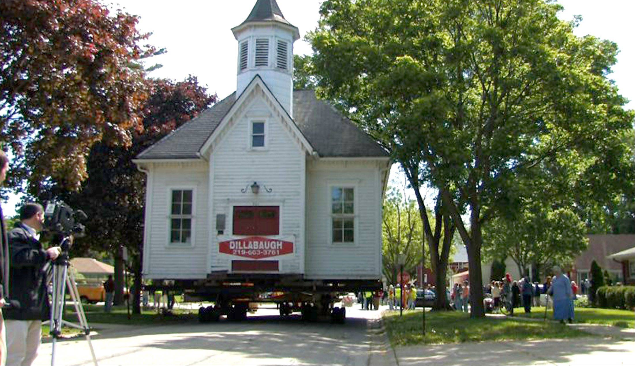 Central School was moved down Main Street from St. John's Episcopal Church to its new home next to the Mount Prospect Historical Society on May 28, 2008. Trees were trimmed and utilities temporarily shut down to accommodate the move.