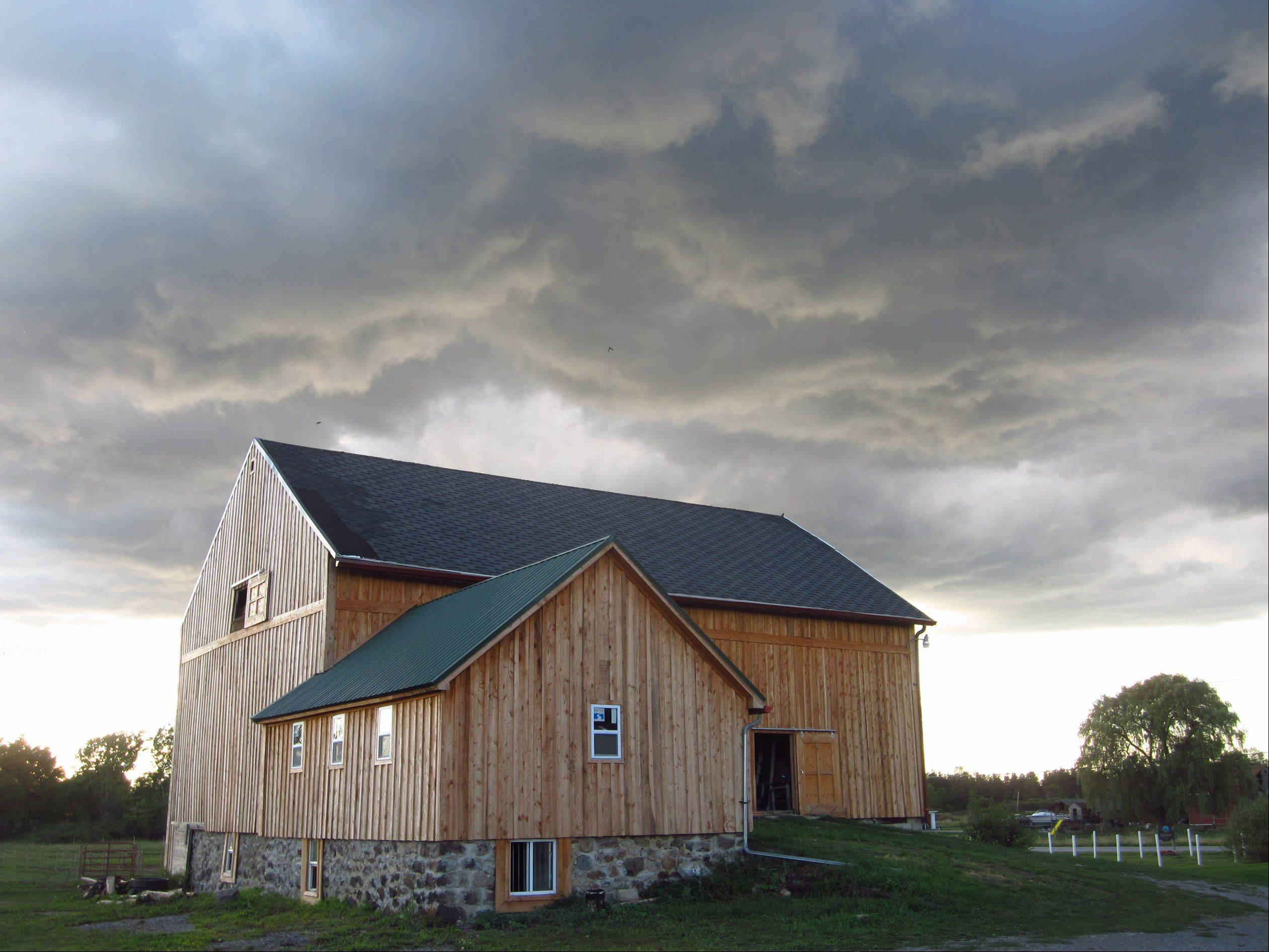 Ominous clouds appear over a newly sided barn at Applewood Farm in Alden, NY in August.
