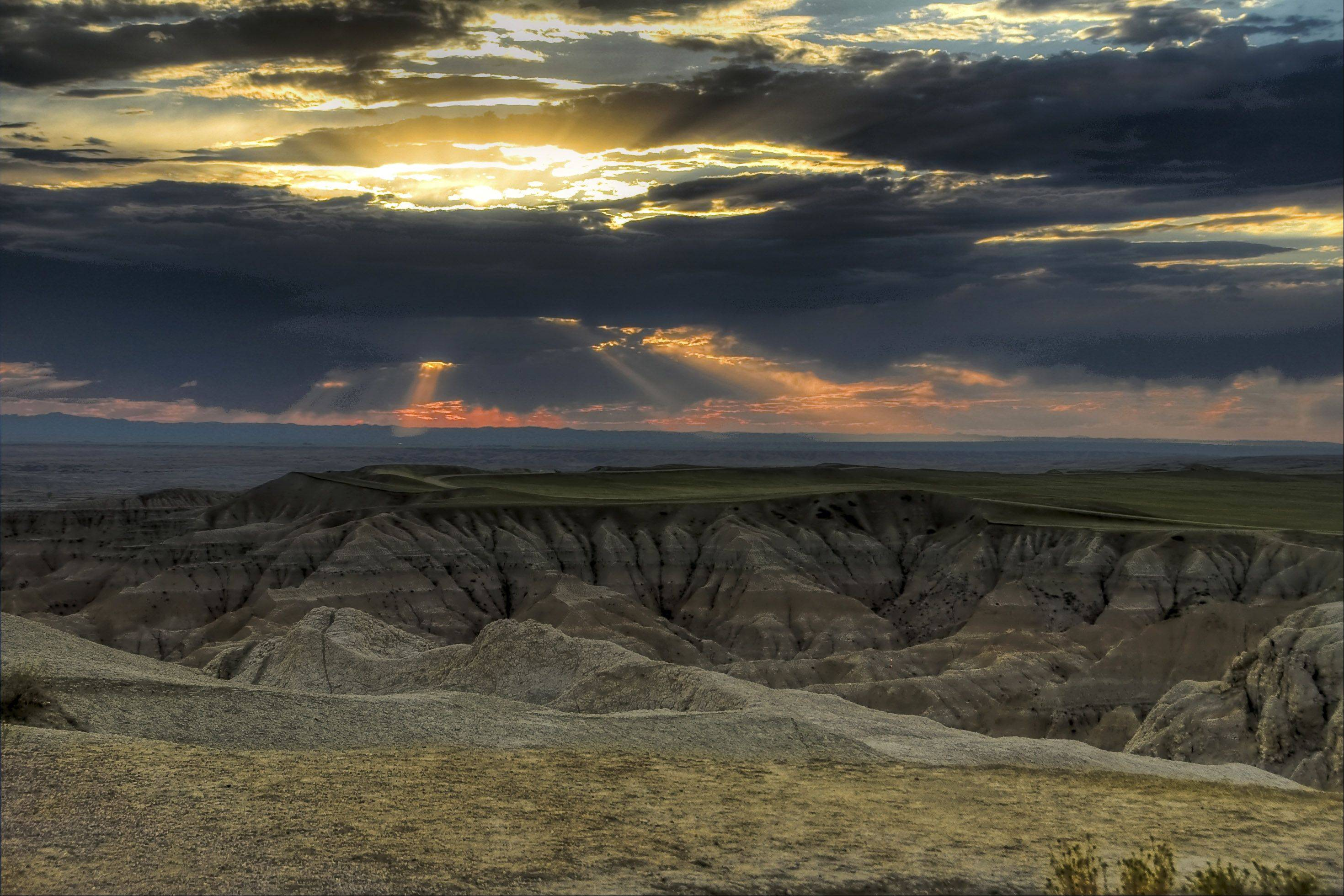 This is a photo of a Badlands sunset taken last week. Arrived in Wall South Dakota with just enough daylight to capture a few colorful moments. It was a great way to start a vacation, and it made up for the hazy smoke filled skies we would later encounter in Wyoming.