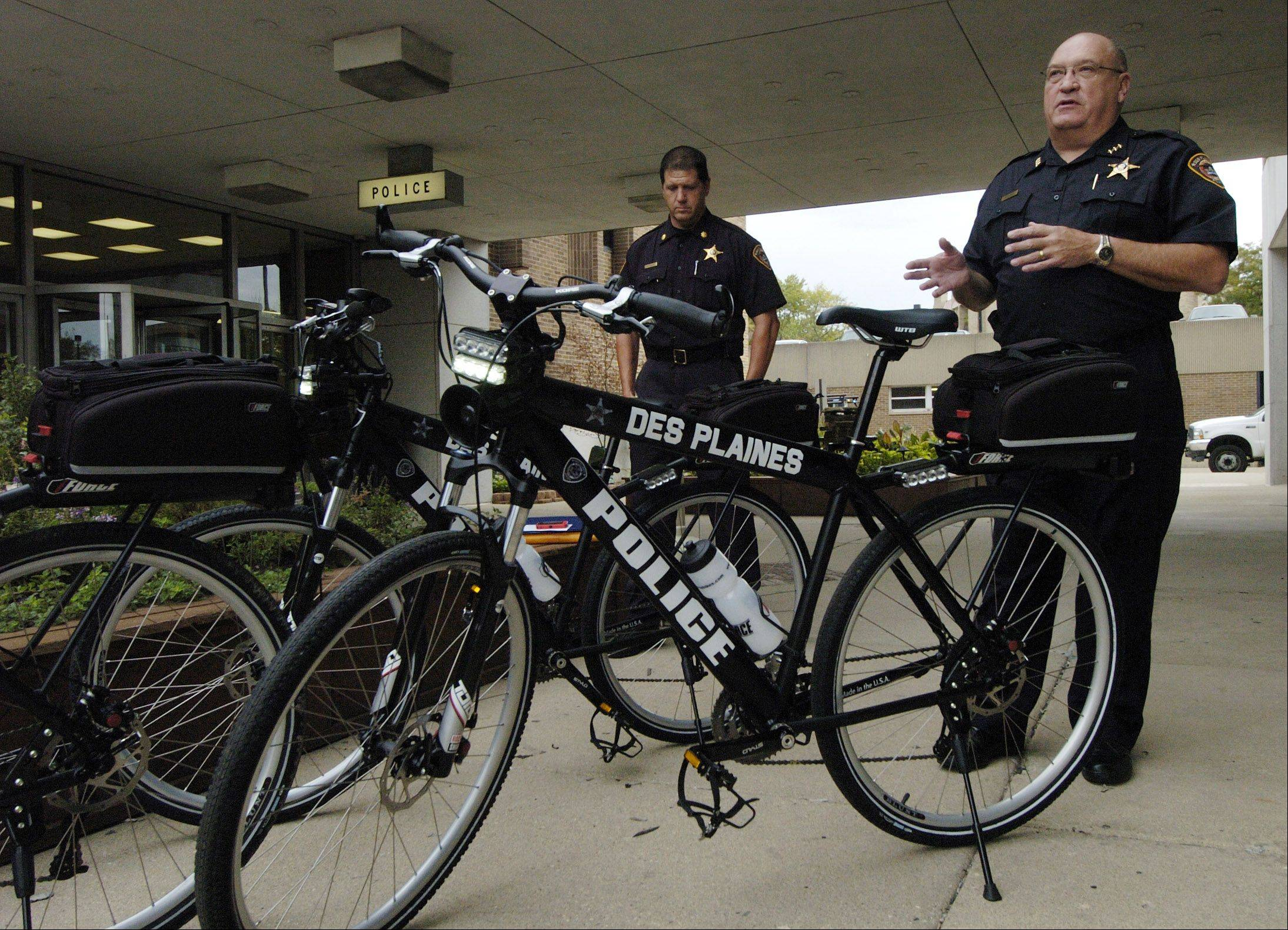Police Chief William Kushner, right, and Cmdr. Dan Niemann talk about the Des Plaines Police Department's new iForce bicycles outside the police station Friday.