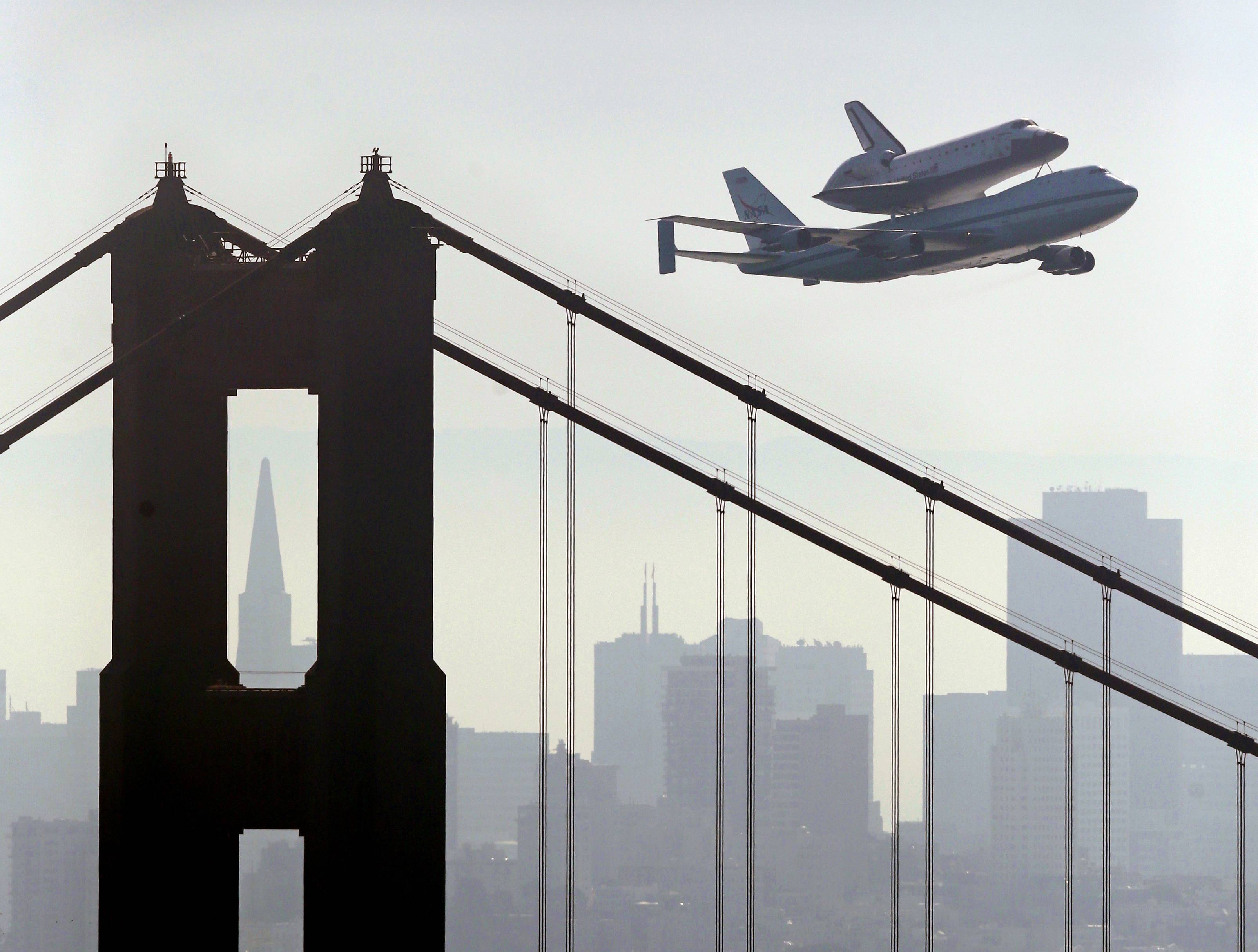 Space Shuttle Endeavour, mounted on NASA's Shuttle Carrier Aircraft, passes over the Golden Gate Bridge Friday in San Francisco. Endeavour is making a final trek across the country to the California Science Center in Los Angeles, where it will be permanently displayed.
