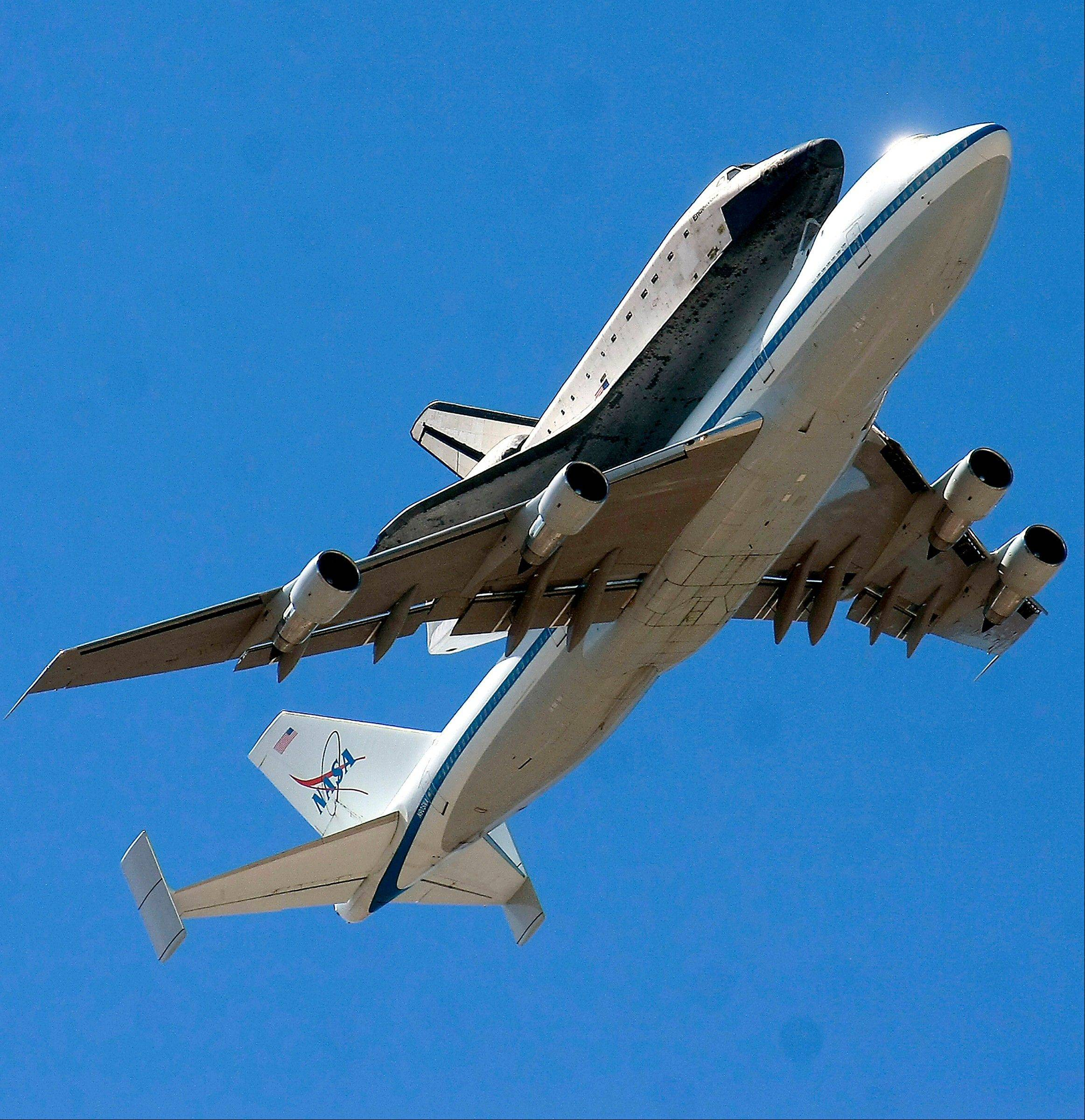 The retired shuttle Endeavour piggybacks a modified Boeing 747 Shuttle Aircraft Carrier during its final flight Thursday, Sept. 20, 2012 as the pair soar over White Sands Missile Range east of Las Cruces, N.M, before reaching their landing destination in California.