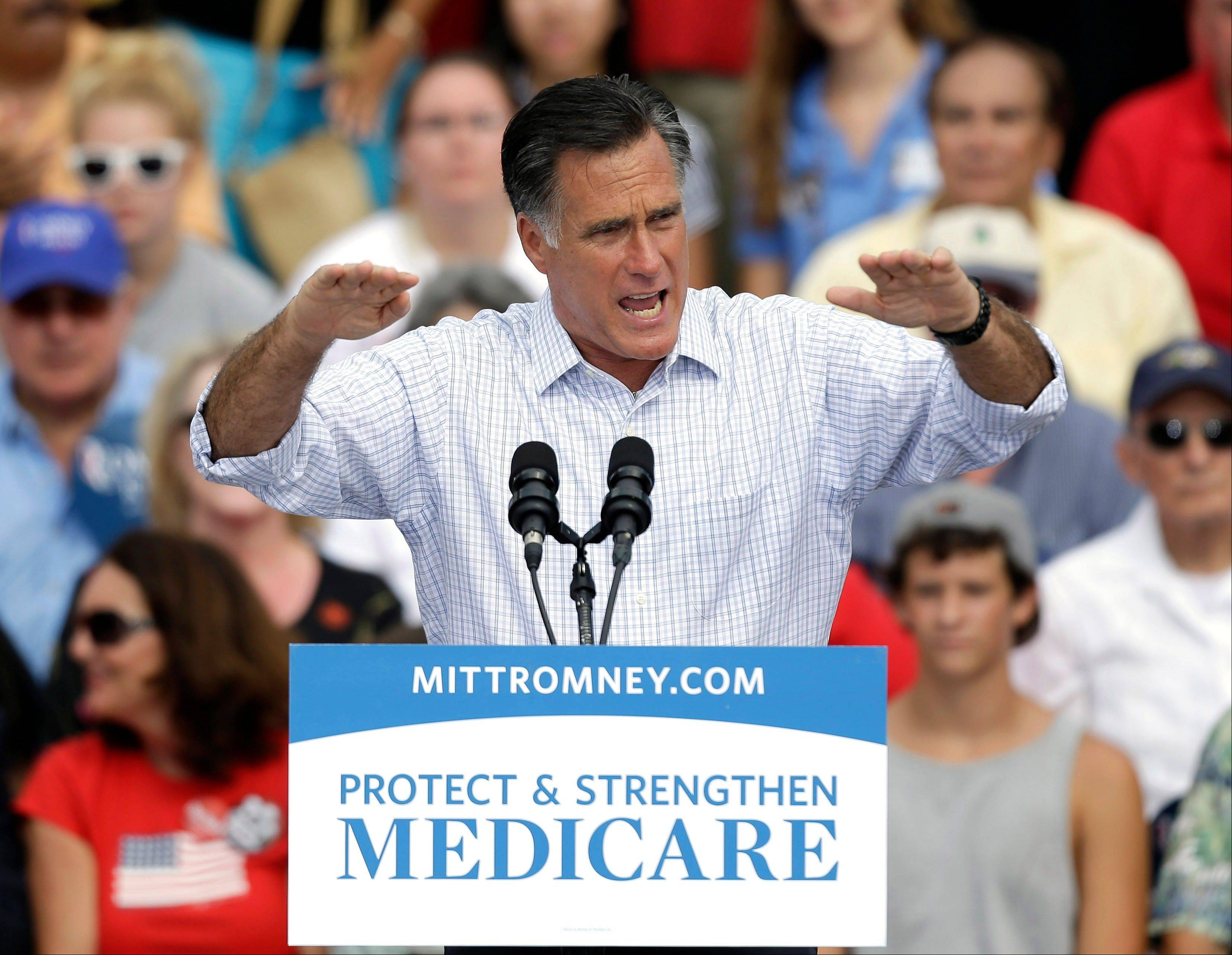 Republican presidential candidate and former Massachusetts governor Mitt Romney gestures during a campaign rally at the Ringling Museum of Art Thursday, Sept. 20, 2012, in Sarasota, Fla. (