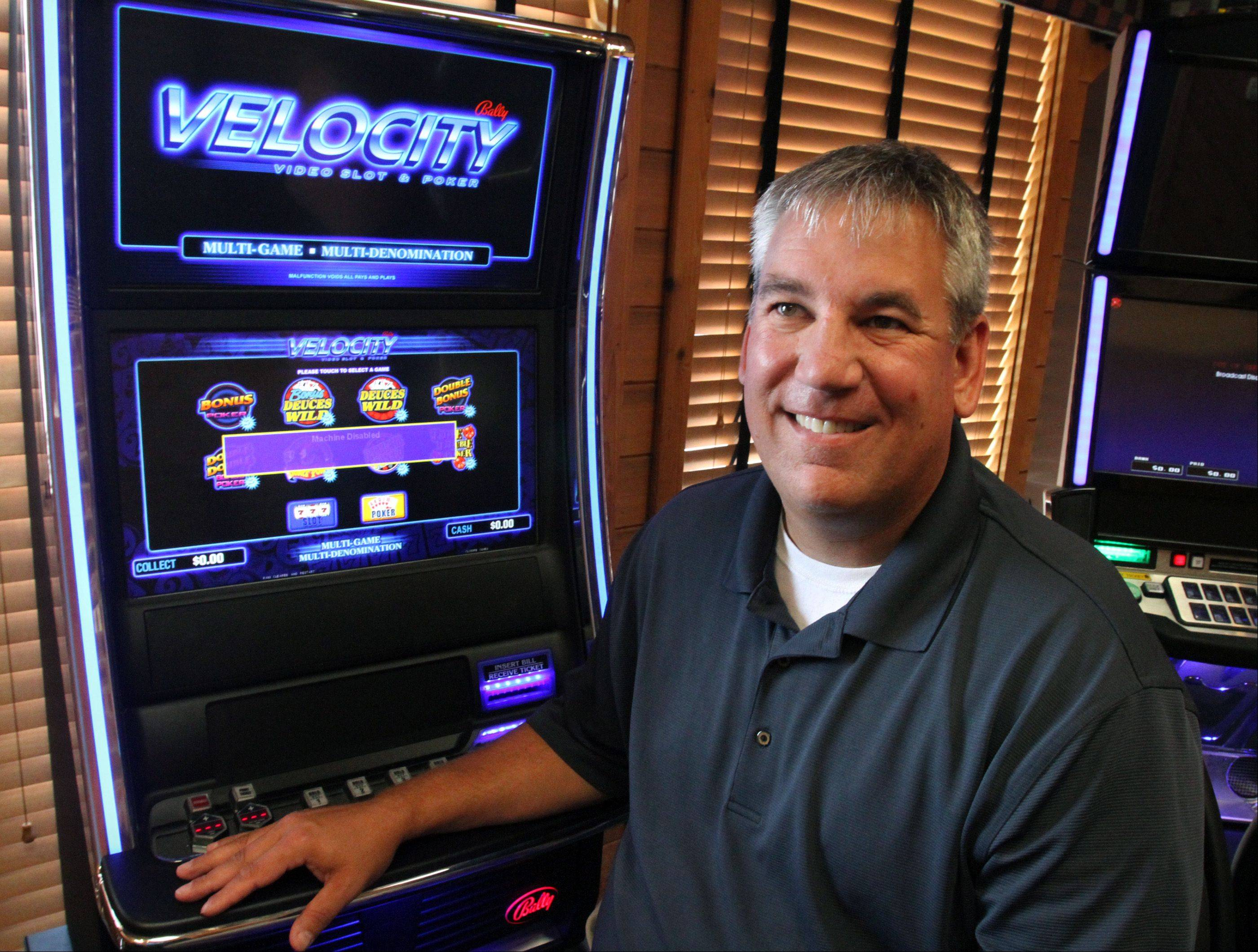 Gary Taylor, co-owner of The Assembly American Bar & Cafe in Hoffman Estates, with one of his video poker machines.