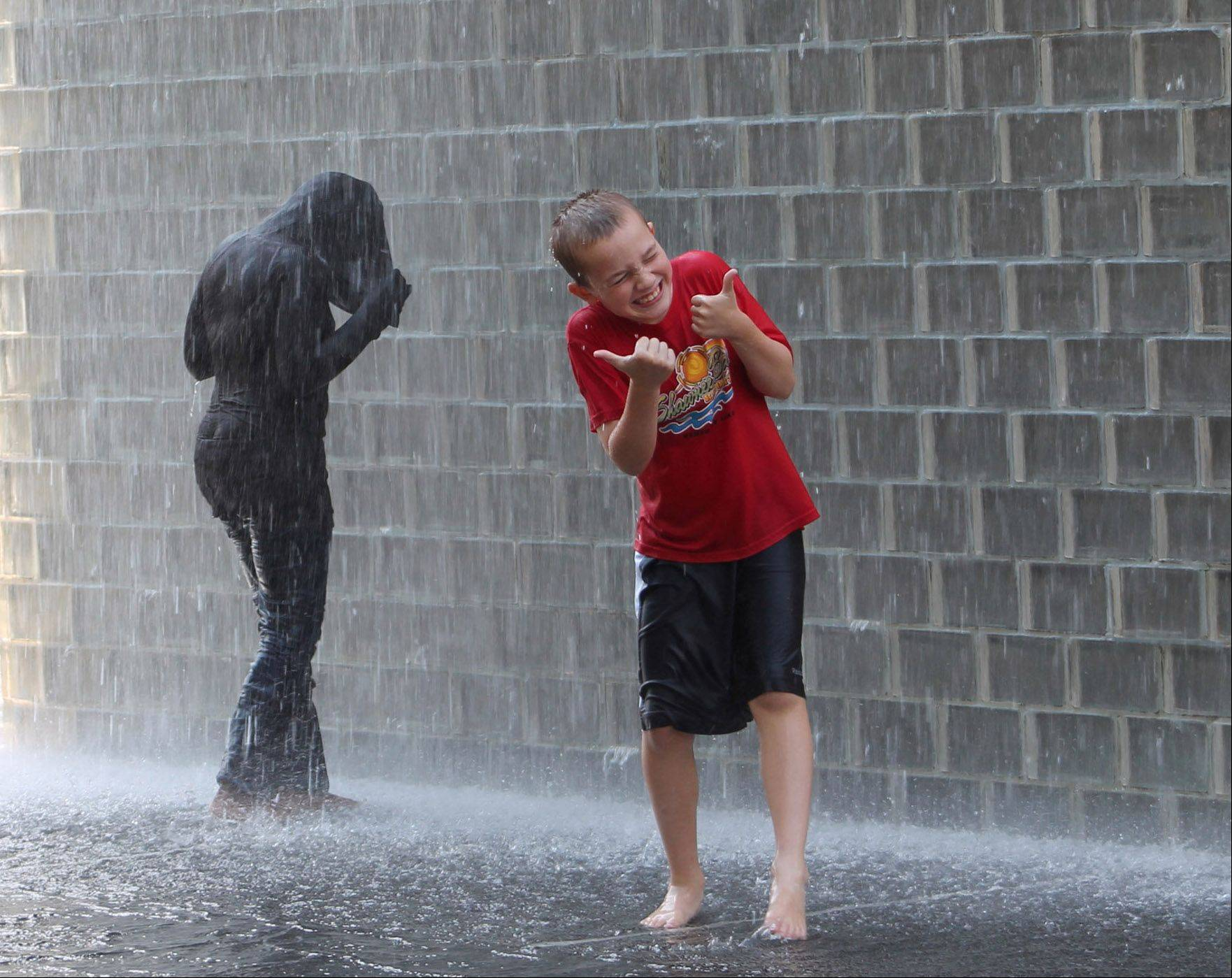 A boy stands in the fountain at Millennium Park in Chicago on August 14th.