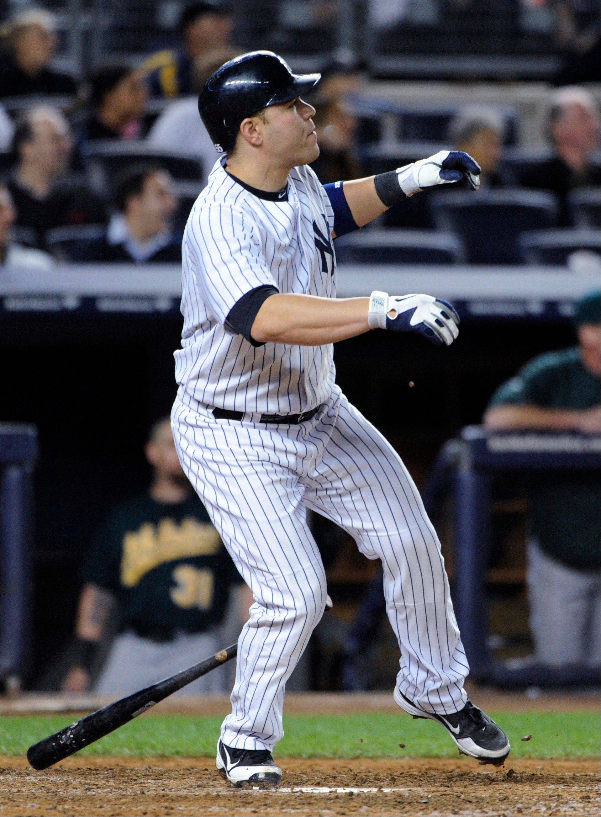 The Yankees' Russell Martin watches his walk-off home run in the 10th inning at home against Oakland.