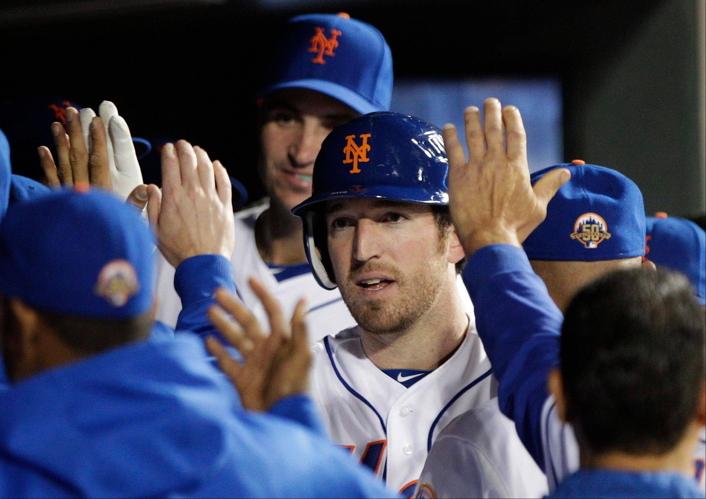 New York's Ike Davis celebrates with teammates after hitting a home run during the seventh inning Friday at home against the Miami Marlins.