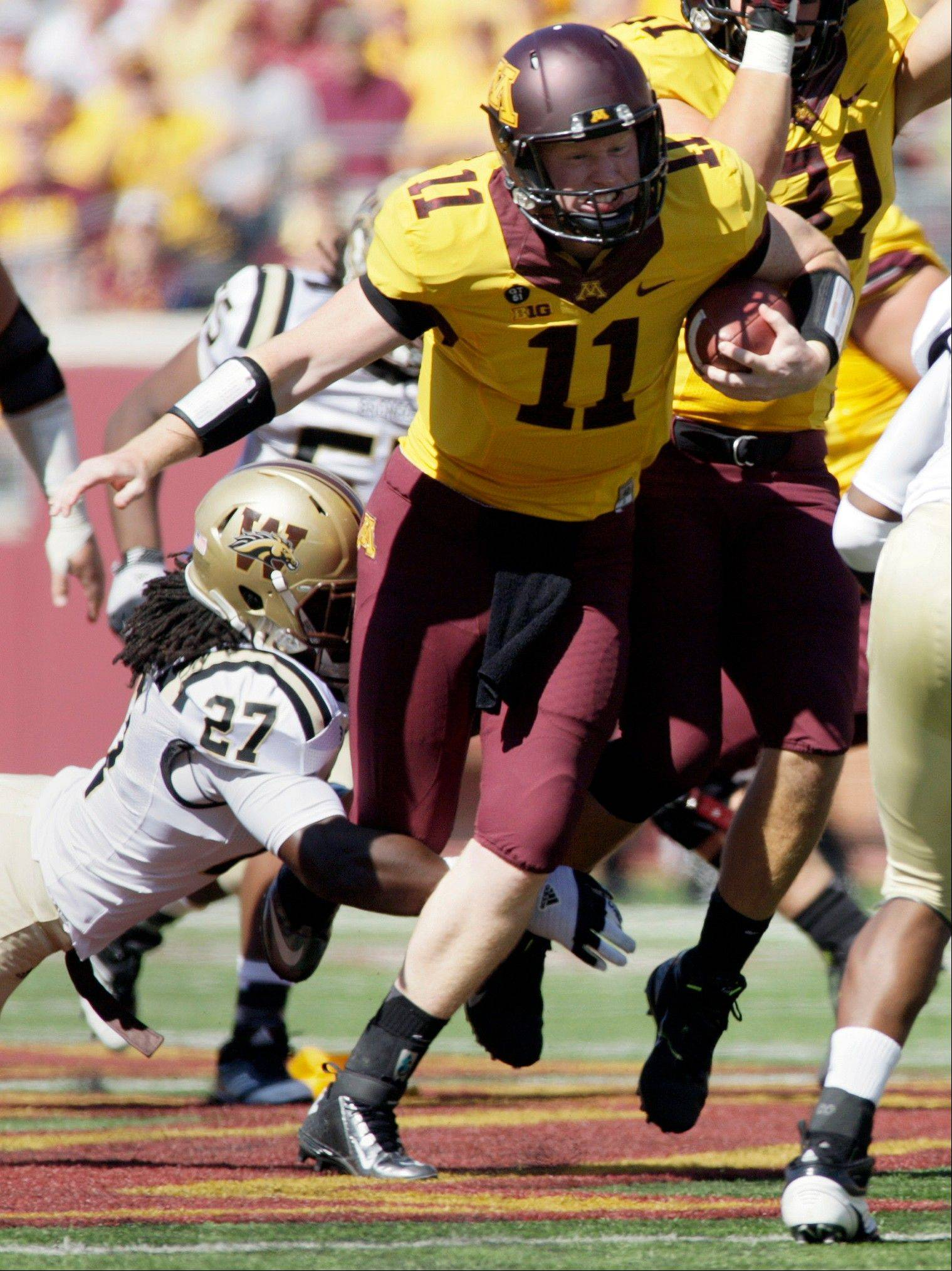 Gophers quarterback Max Shortell breaks the tackle of Western Michigan safety Trevor Ishmael during the first half of last Saturday's game in Minneapolis. Minnesota won 28-23.