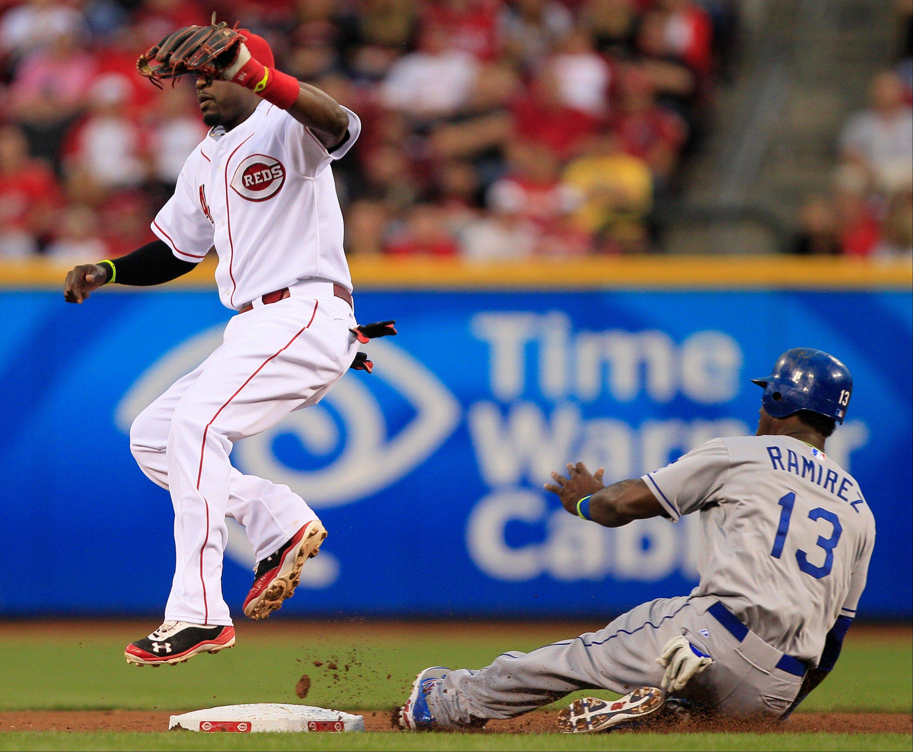 The Dodgers' Hanley Ramirez steals second base as Reds second baseman Brandon Phillips catches the late throw in the second inning Friday in Cincinnati.