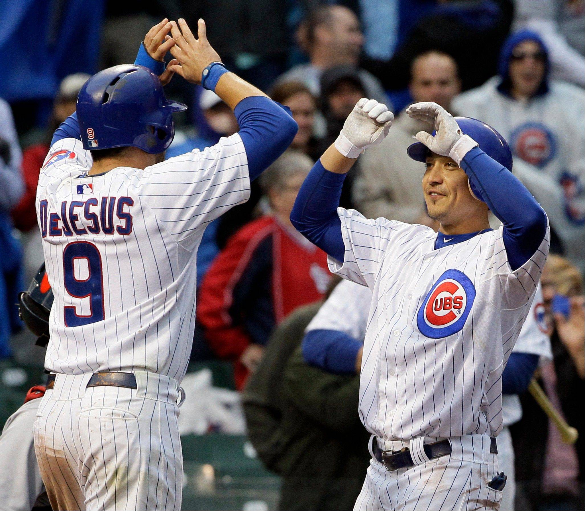 Chicago Cubs' Darwin Barney, right, celebrates with David DeJesus after hitting a two-run home run during the ninth inning of a baseball game against the St. Louis Cardinals in Chicago, Friday, Sept. 21, 2012. The Cubs won 5-4.