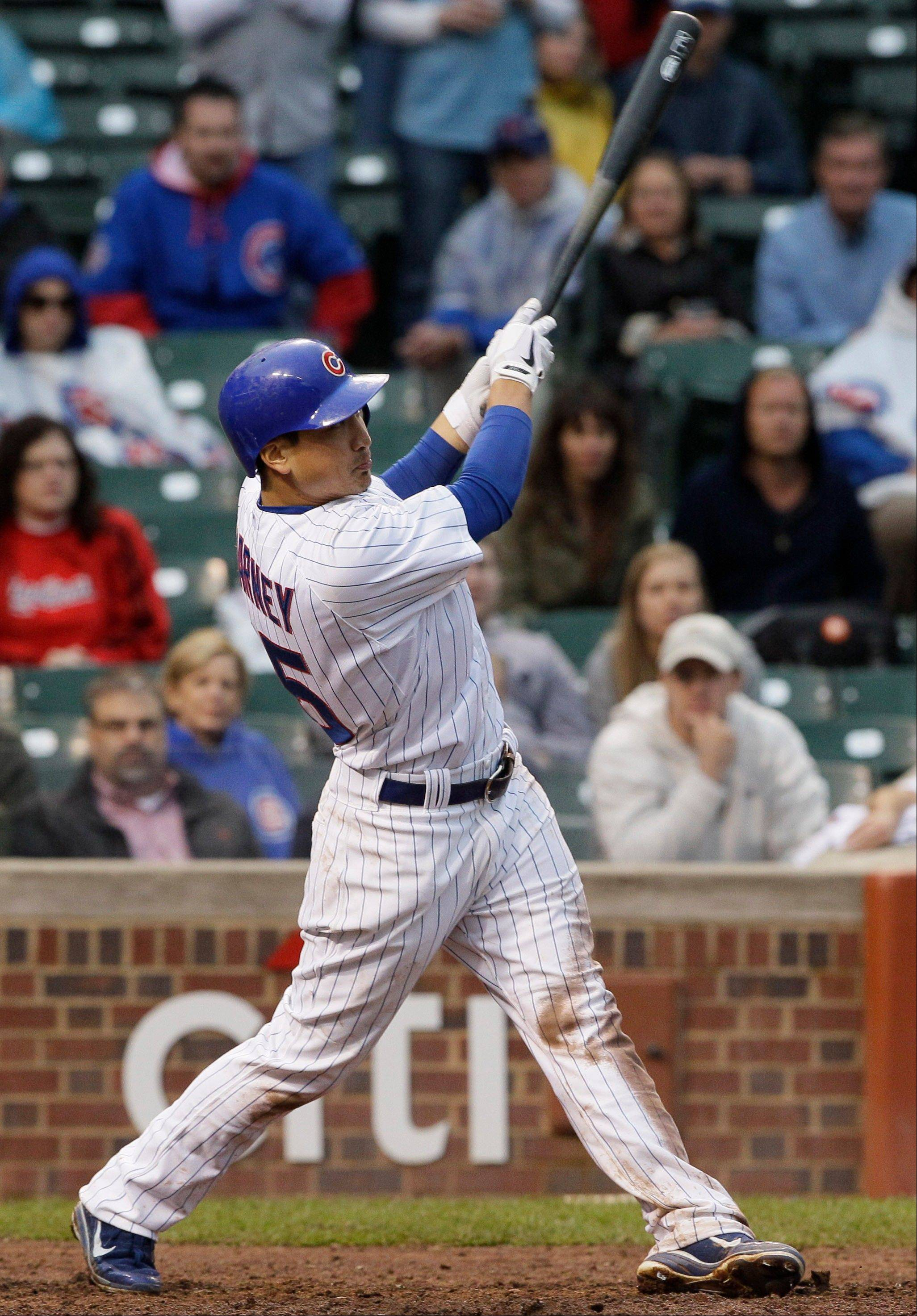 Chicago Cubs' Darwin Barney hits a two-run home run during the ninth inning of a baseball game against the St. Louis Cardinals in Chicago, Friday, Sept. 21, 2012. The Cubs won 5-4.