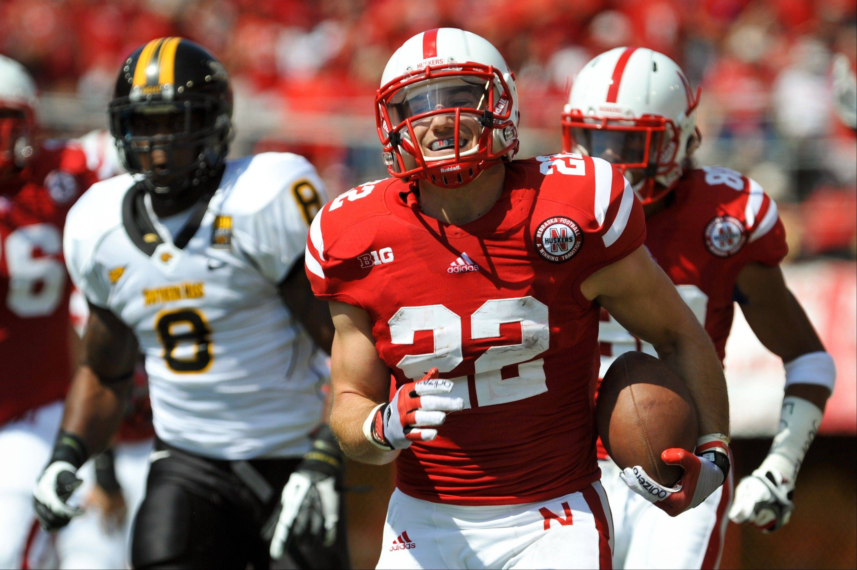 Nebraska's Rex Burkhead runs 57 yards for a touchdown against Southern Miss on Sept. 1. He's missed the last two games with a sprained ligament.