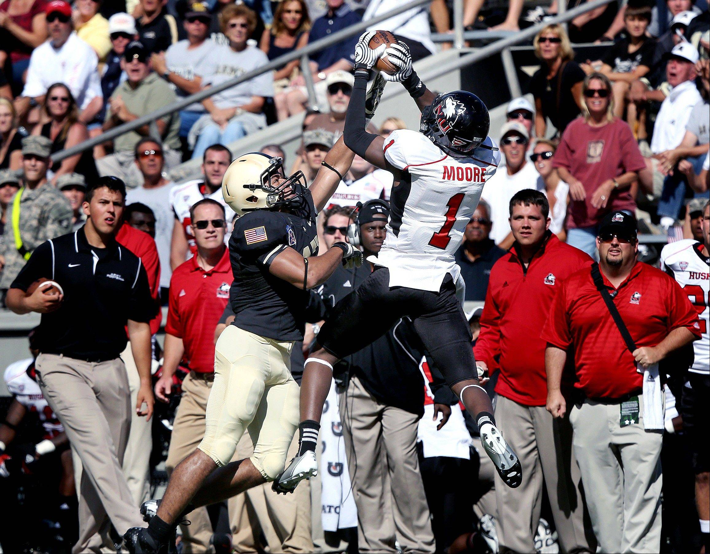 NIU's Martel Moore catches a pass over Army's Tyler Dickson on a drive that lead to the game-winning touchdown last Saturday.