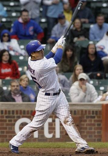 Darwin Barney spoiled Chris Carpenter's season debut with a two-run, tying homer with two outs in the ninth inning, and David DeJesus smacked a game-winning single in the 11th to lift the Cubs over the playoff-hopeful St. Louis Cardinals 5-4 on Friday.