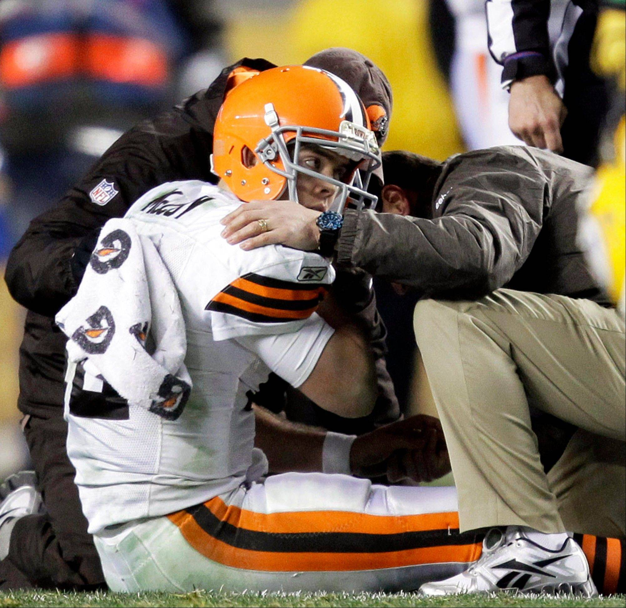 Trainers tend to Cleveland Browns quarterback Colt McCoy after he was hit by Pittsburgh Steelers outside linebacker James Harrison in a game last December. McCoy sustained a concussion.