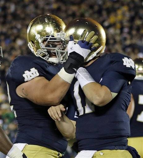 Manti Te'o had two interceptions as No. 11 Notre Dame picked off five Michigan passes and backup quarterback Tommy Rees sparked the Fighting Irish offense in a 13-6 win over the 18th-ranked Wolverines Saturday night.
