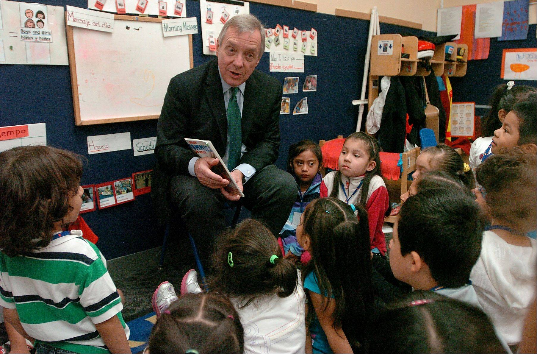 U.S. Sen. Dick Durbin reads to preschoolers at the Palatine Opportunity Center.