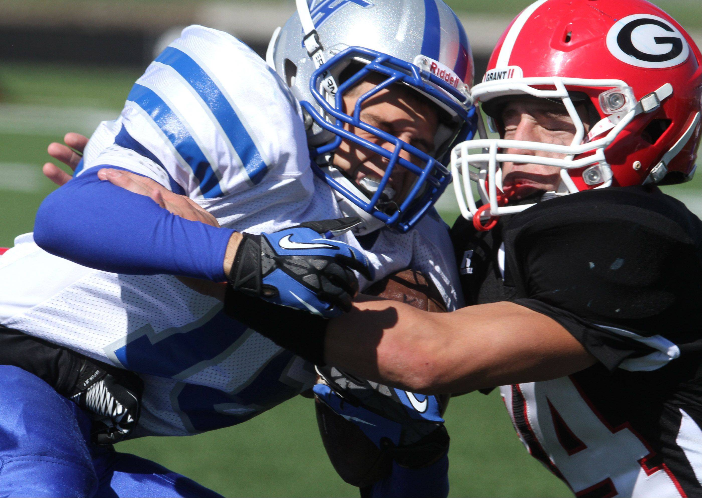 Vernon Hills running-back Ilya Fedorovich is tackled by Grant defender Dan King on Saturday, September 22.
