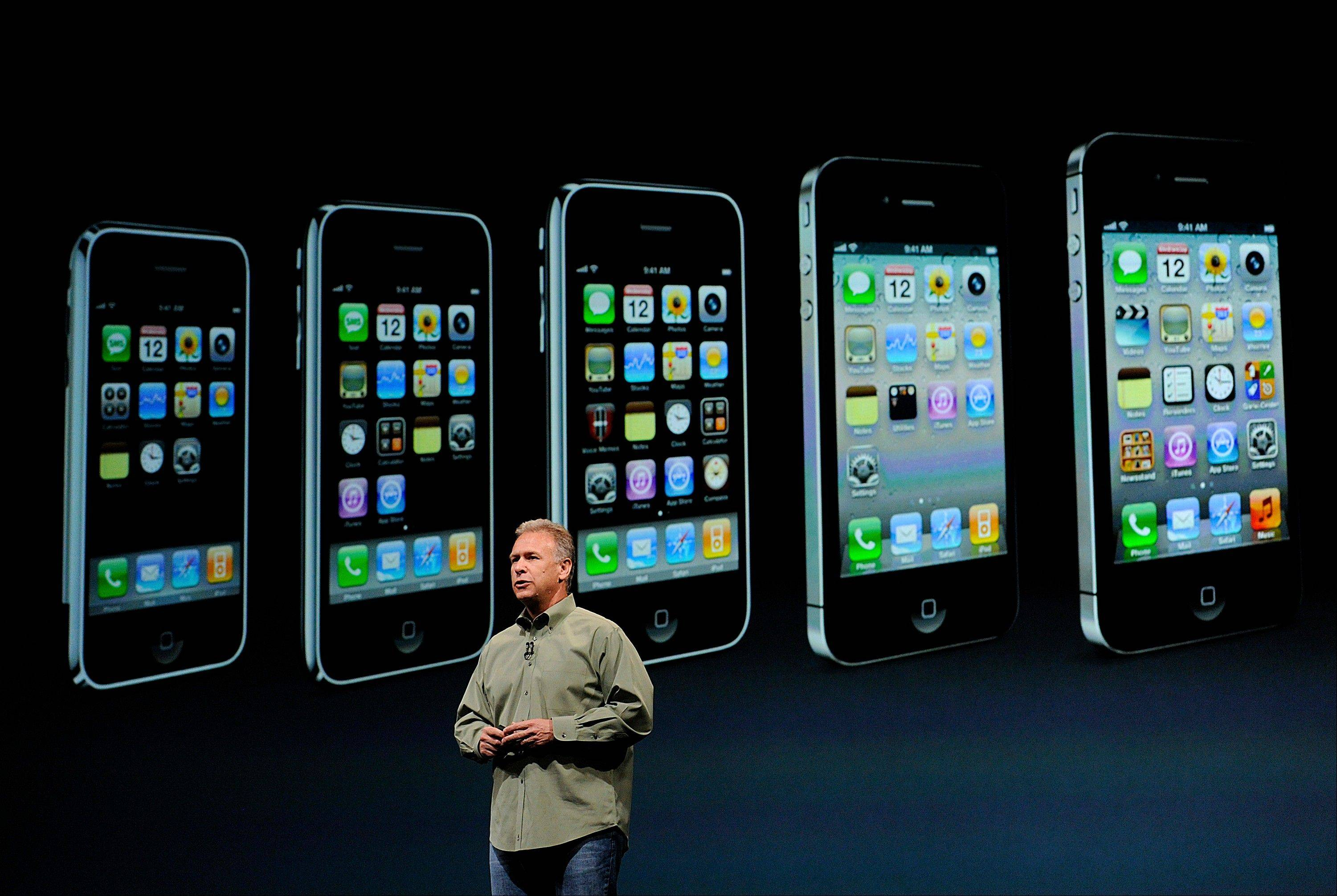 "Philip ""Phil"" Schiller, senior vice president of worldwide marketing at Apple Inc., speaks during an event in San Francisco. Apple's basic new iPhone costs the company just more than $200 to make, according to a preliminary component report from analysis firm IHS iSuppli."