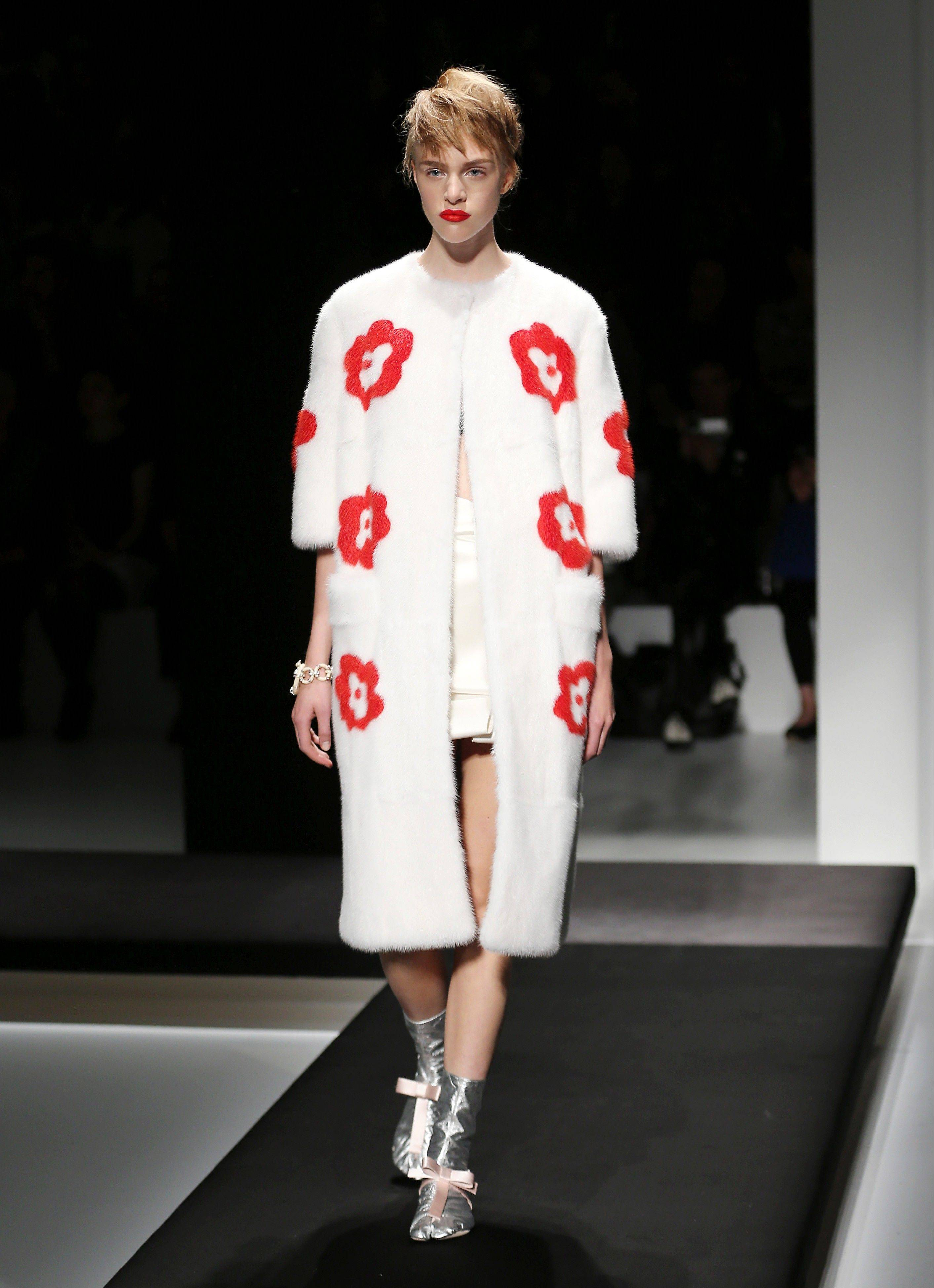 A model wears a floral creation that's part of the Prada Women's Spring-Summer 2013 fashion collection in Milan.