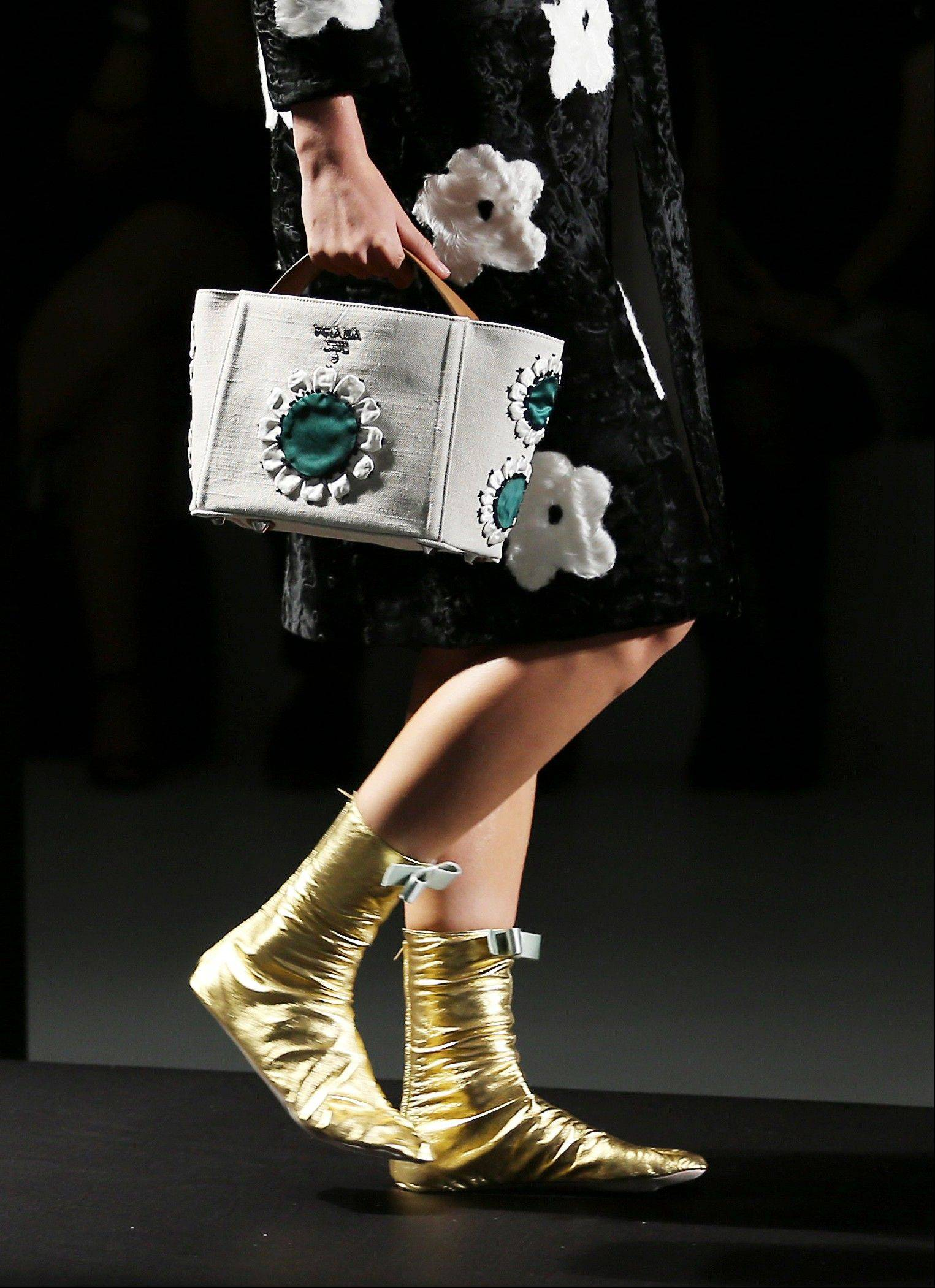The central motif of Prada's new collection is a graphic flower, which appeared on bags, tops, dresses, wraps and eyewear.