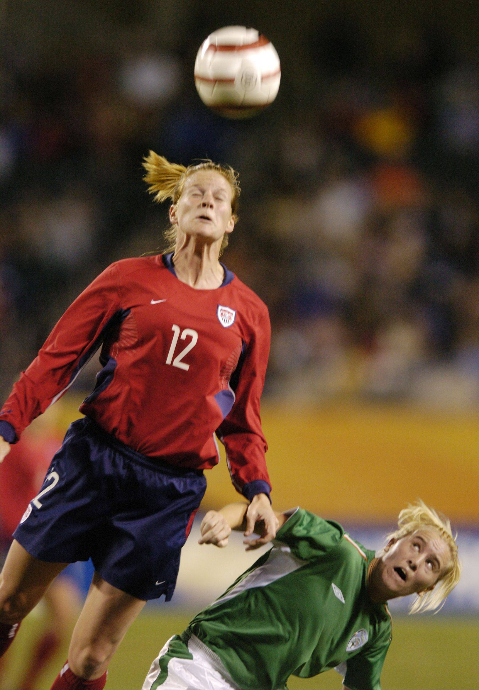 U.S. soccer player Cindy Parlow wins a header against Ireland's Michelle Walsh during a game at Soldier Field in 2004. Parlow retired in 2006 because of post-concussion syndrome.