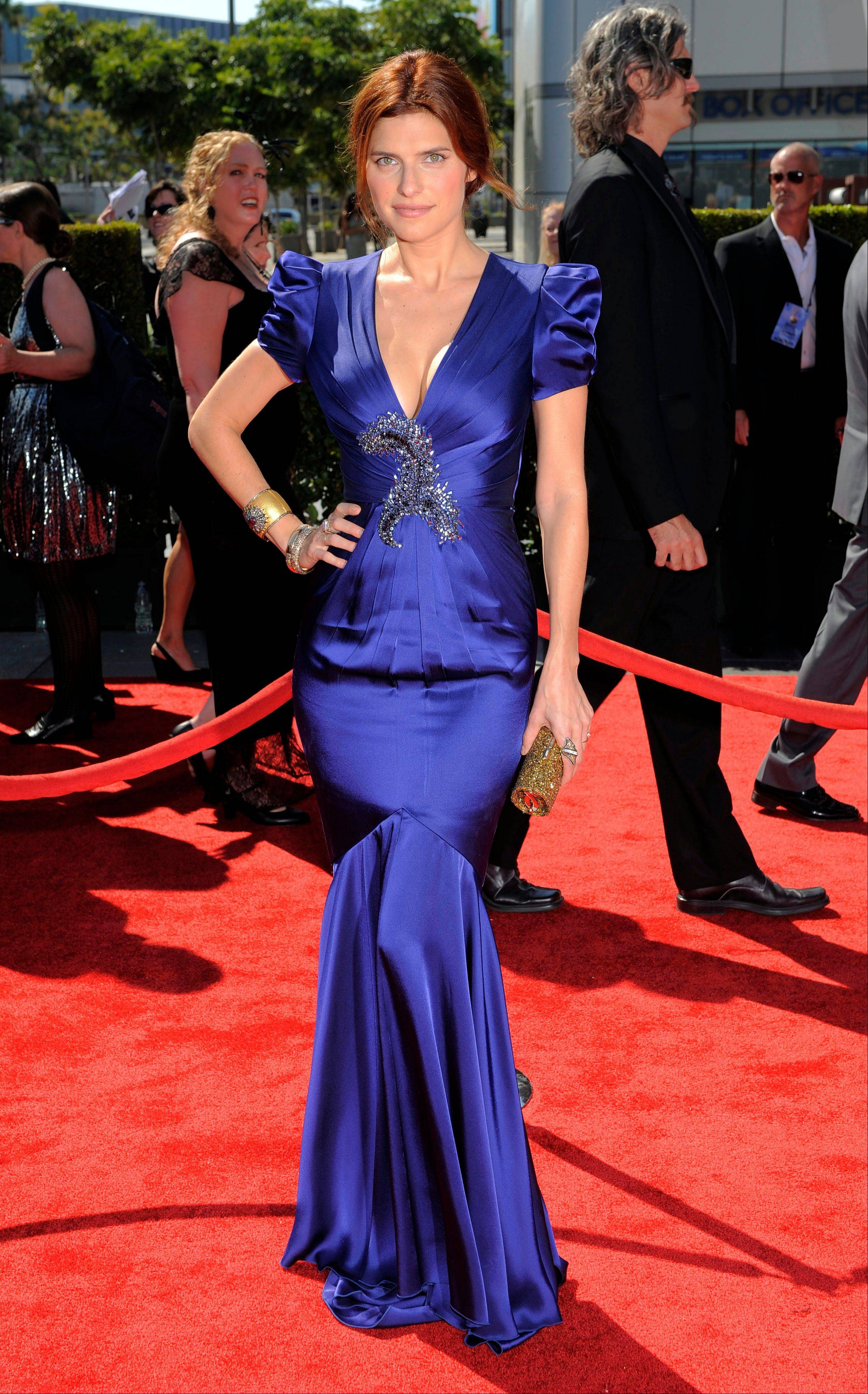 With the temperature topping 100 degrees last Saturday in Los Angeles, actress Lake Bell suggested not moving much to avoid sweating and achieved that in her narrow French gown at the 2012 Creative Arts Emmys.