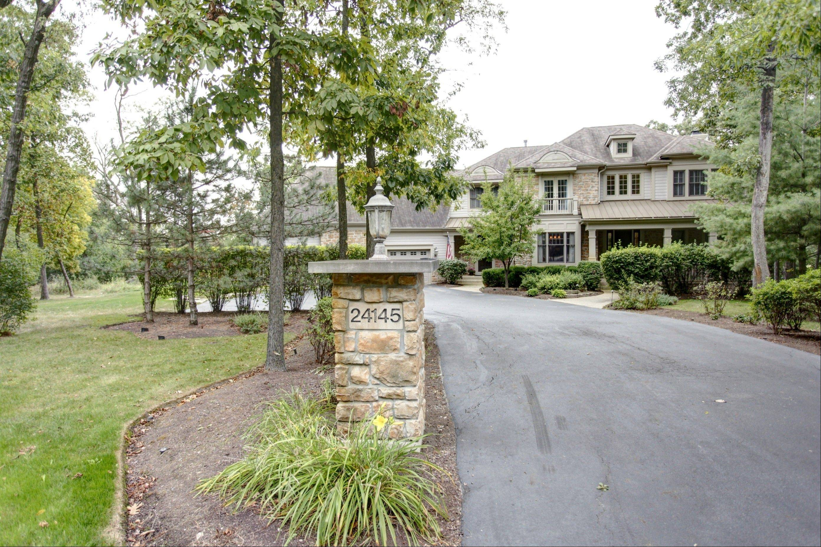 This Hawthorn Woods home sits on 2� wooded acres.