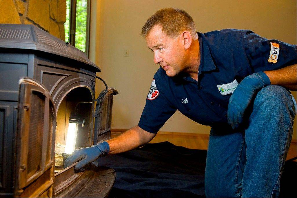 Jeffery Peterson of Potomac Services inspects a free-standing fireplace in Sterling, Va.