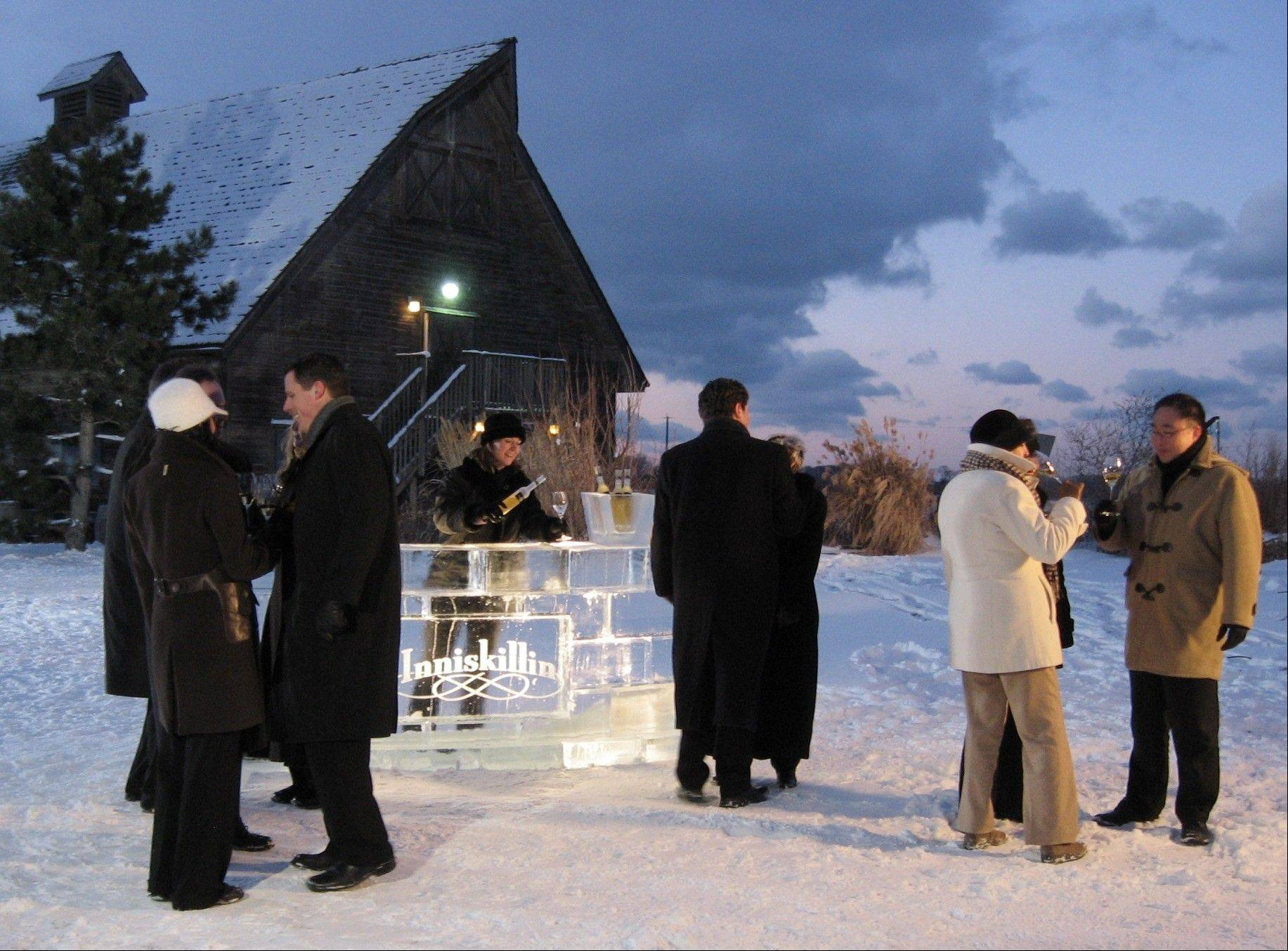 Visitors enjoy the Niagara-on-the-Lake's annual winter icewine festival in Ontario, Canada. More than two dozen wineries are best-known for a specialty wine called icewine that's made from frozen grapes.