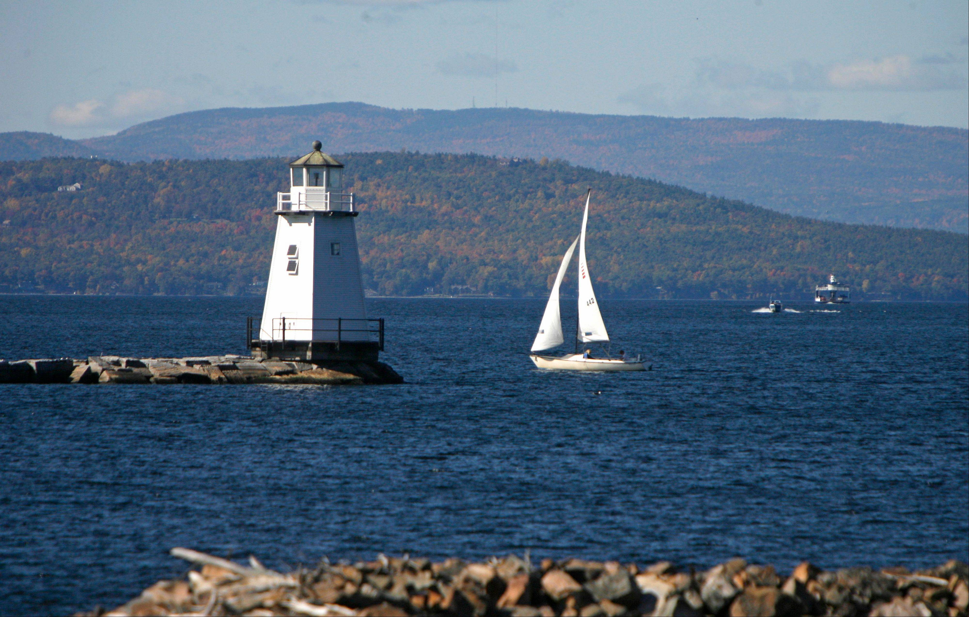 Boats travel across the waters of Lake Champlain in Burlington, Vt.