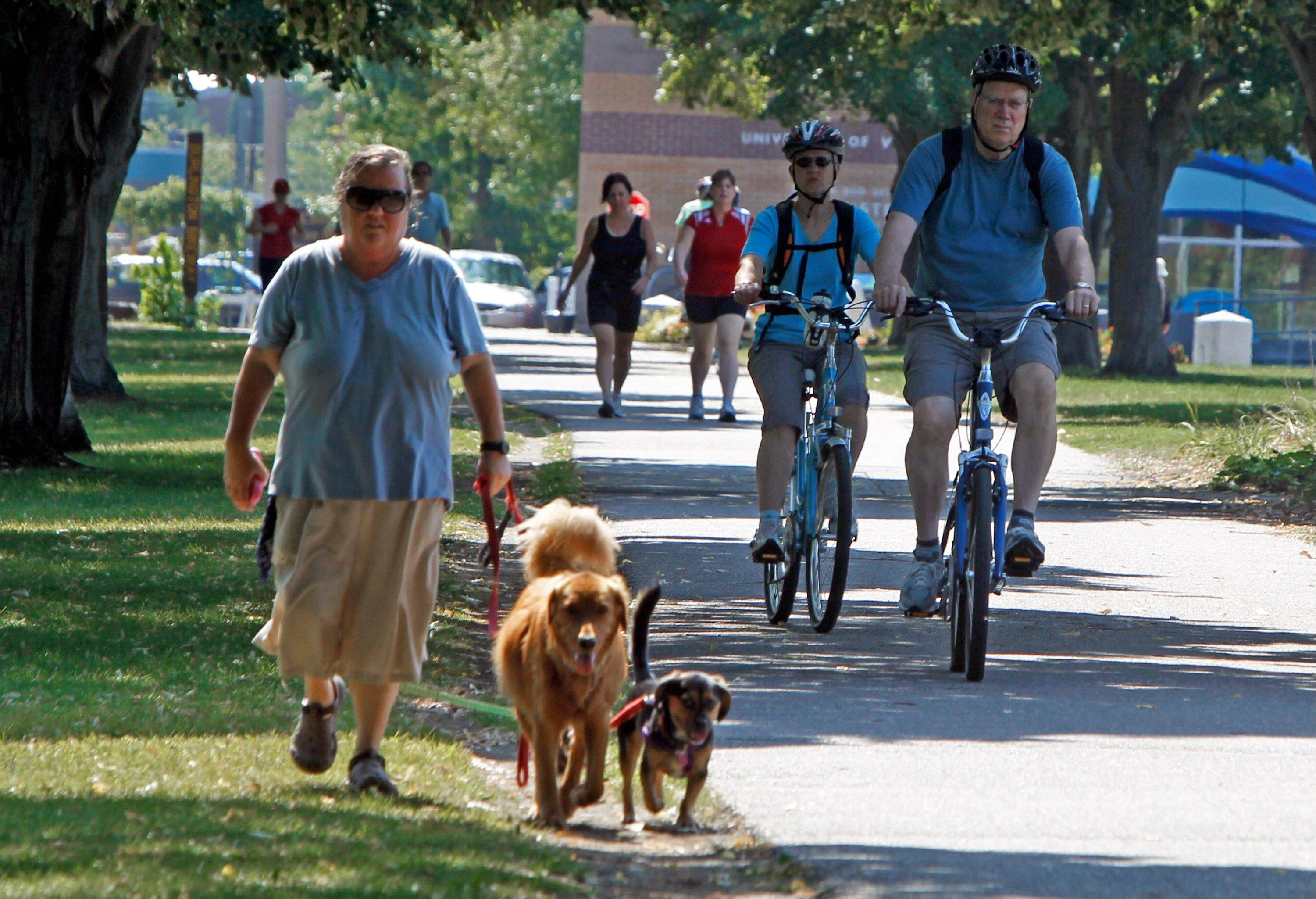 People use the Burlington bike path in Burlington, Vt. Burlington feels more like a big town than a city.