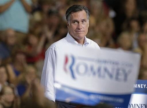 Republican presidential candidate and former Massachusetts Gov. Mitt Romney pauses as supporters cheer to remarks during a rally Sept. 21 in Las Vegas.