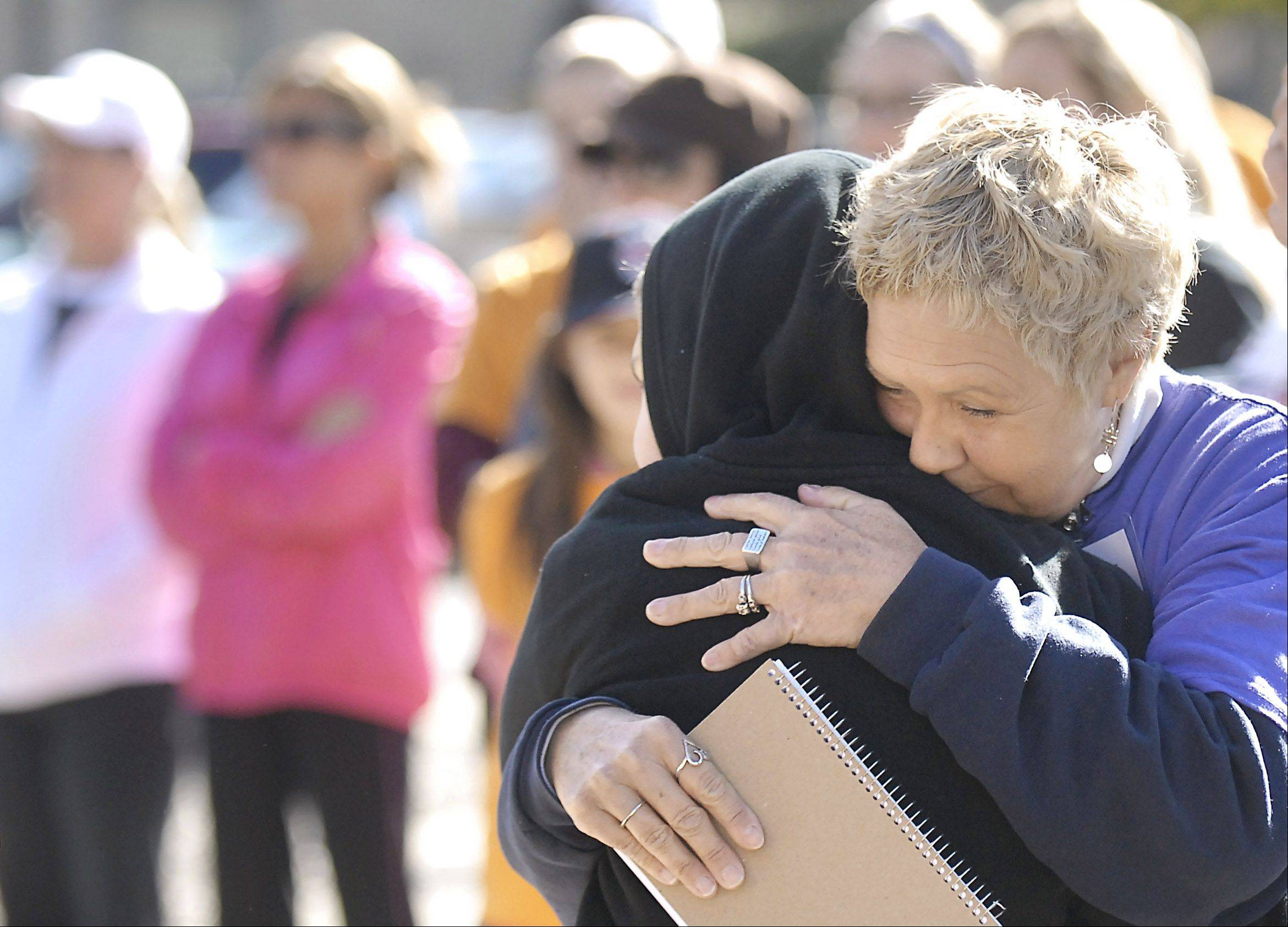 Jan Hanczar of St. Charles hugs her grandson, Calvin Carlson, 9, also of St. Charles, after speaking on Saturday about how Fox Valley Volunteer Hospice helped her family during difficult times. Stefani Hanczar, Jan Hanczar's daughter and Calvin's mother, died in 2008. Hanczar also lost her son Jamie Hall in 2008 and her brother David Gordon in 2010.