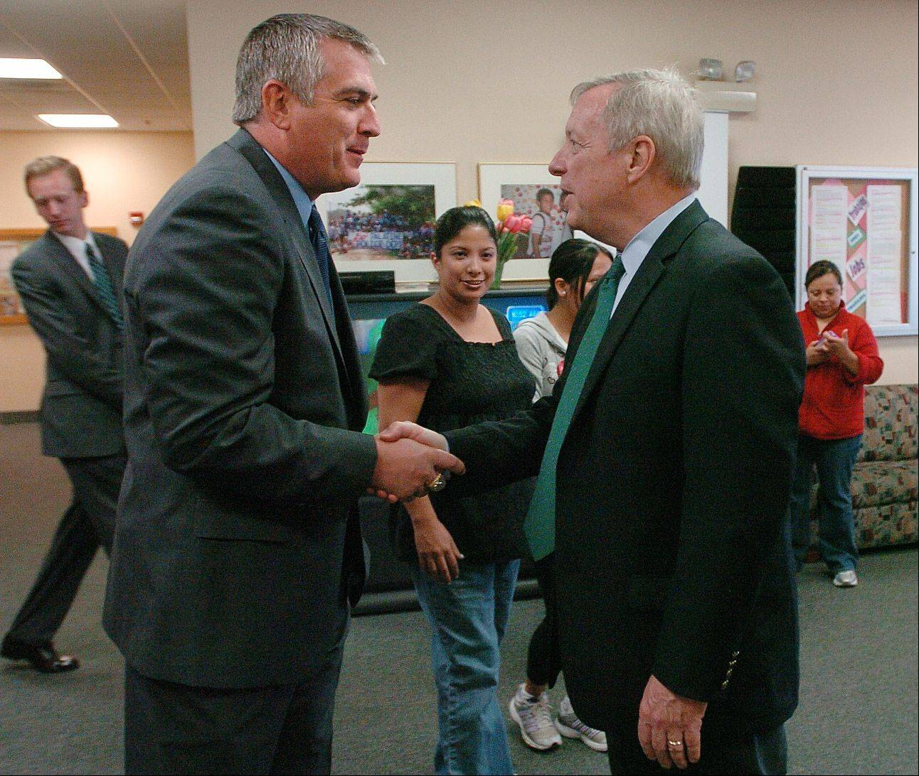 Dick Durbin is greeted by Palatine Mayor Jim Schwantz.
