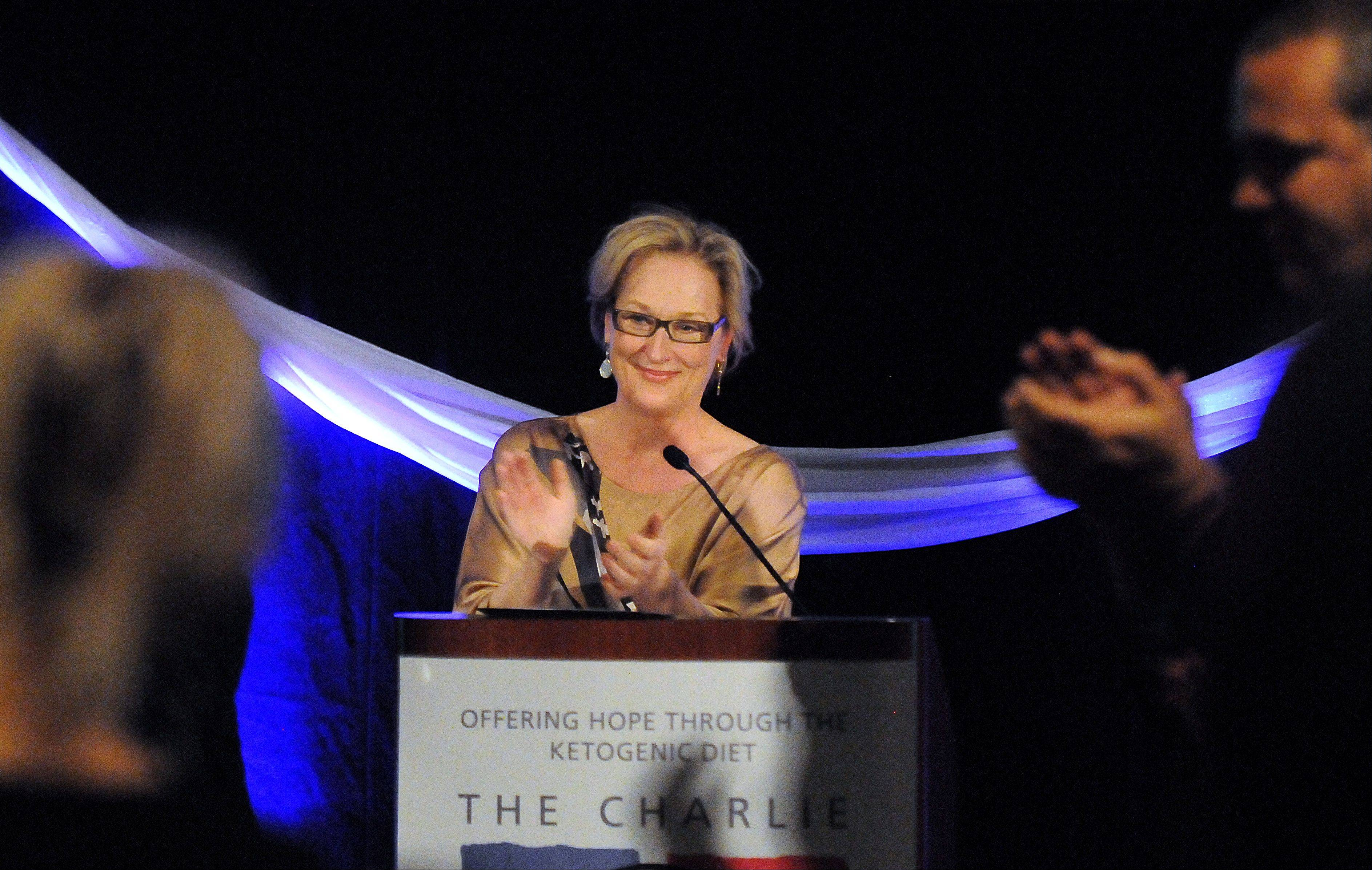 Meryl Streep takes the podium for a speech and applauds the parents of epileptic children and all those involved in helping them on Friday at a fundraiser for The Charlie Foundation to Help Cure Pediatric Epilepsy, held at Hilton Chicago Indian Lakes Resort in Bloomingdale.