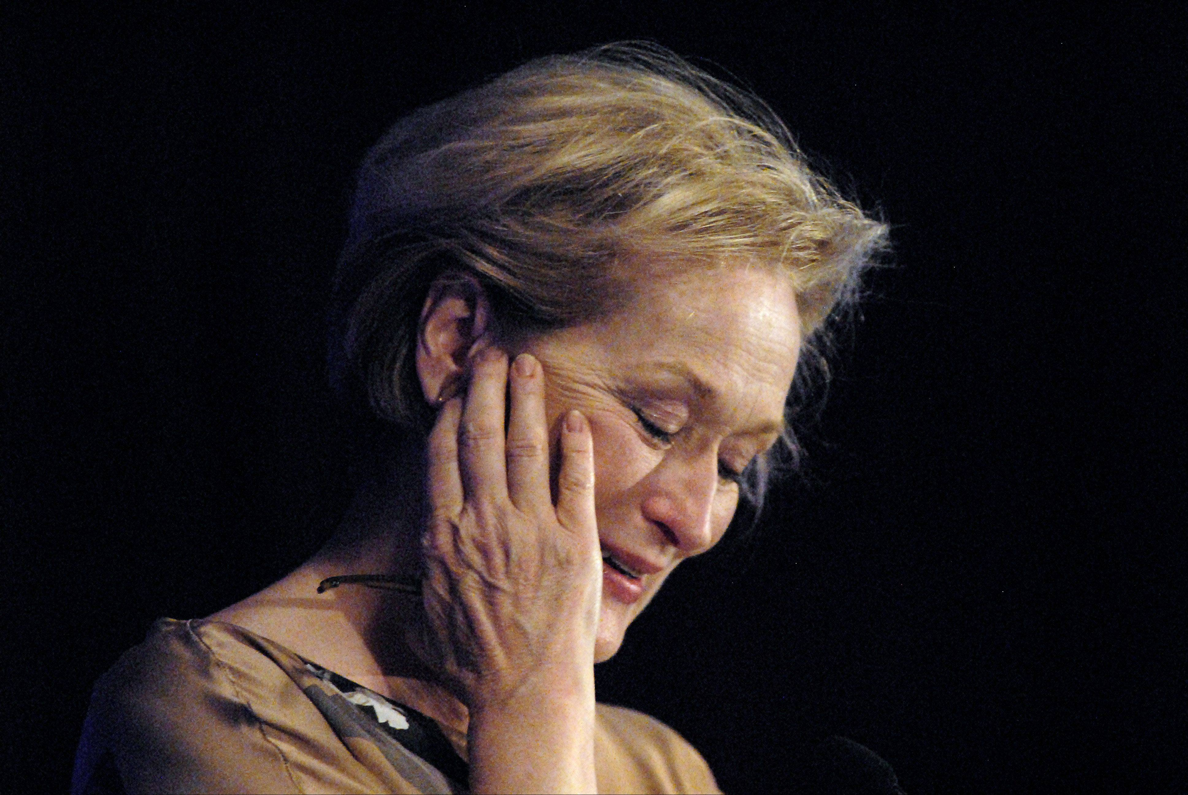 Meryl Streep wipes away tears Friday after being introduced by Charlie Abrahams, the namesake for The Charlie Foundation to Help Cure Pediatric Epilepsy.