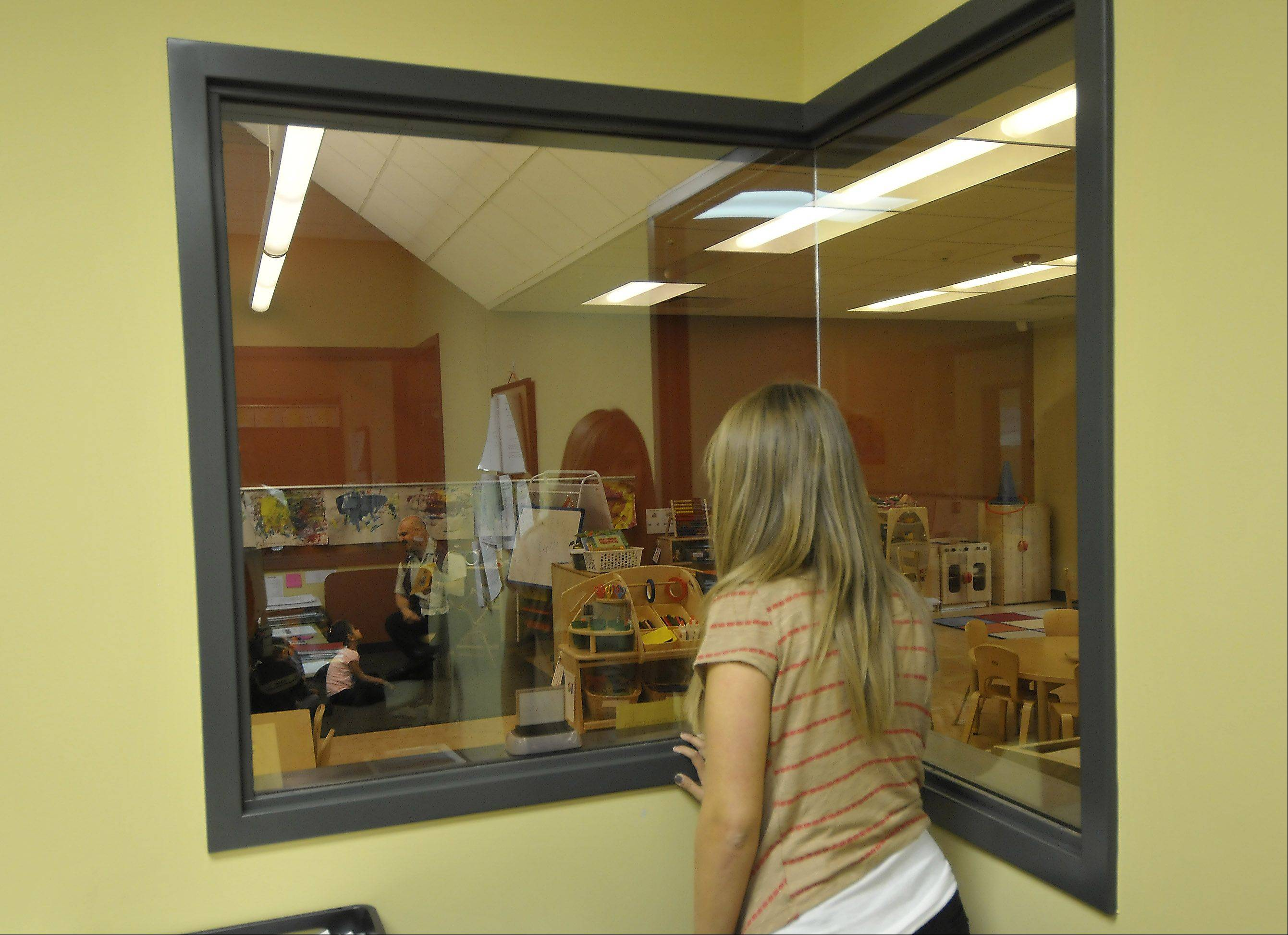 One of the features of the Educare of West DuPage building is two-way mirrors that allow parents to observe their kids in the classes. This helps achieve the new school's goal of supporting parental involvement.