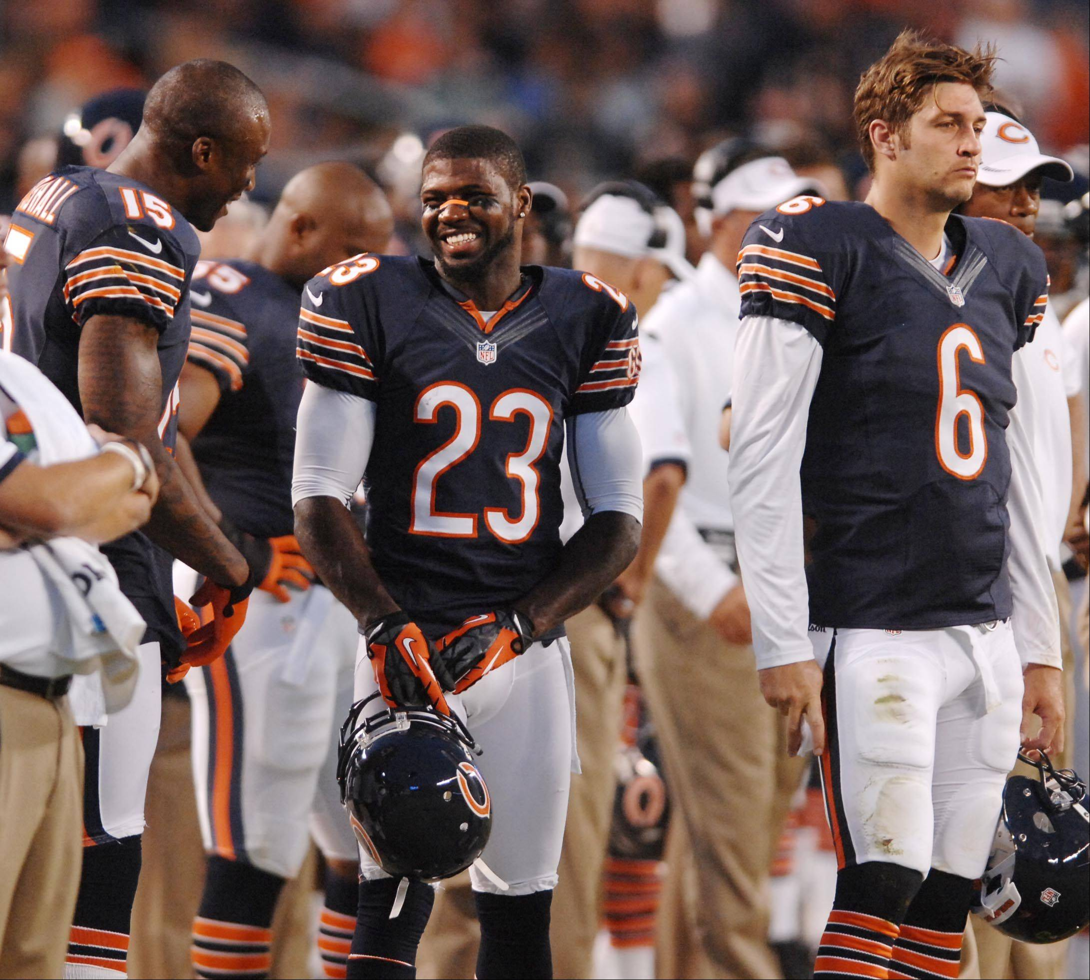 Devin Hester smiles with Brandon Marshal, left, and Jay Cutler, right, against the Washington Redskins in the second preseason game at Soldier Field in Chicago.