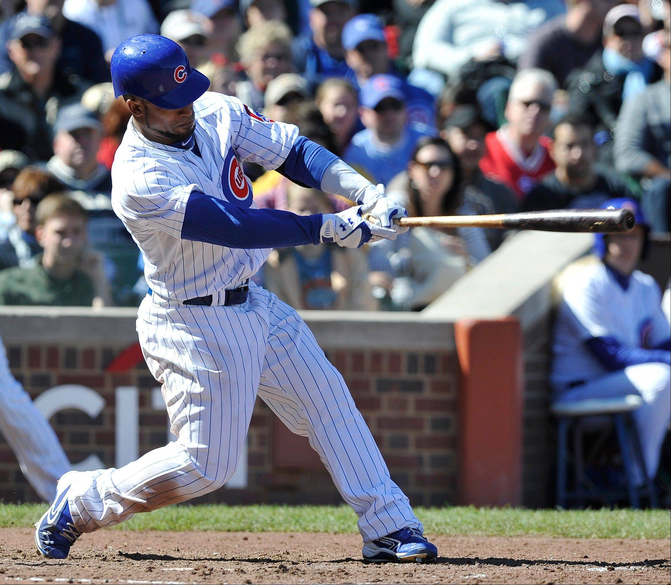 The Cubs' Dave Sappelt drives in run with a single against the St. Louis Cardinals Saturday during the sixth inning at Wrigley Field.
